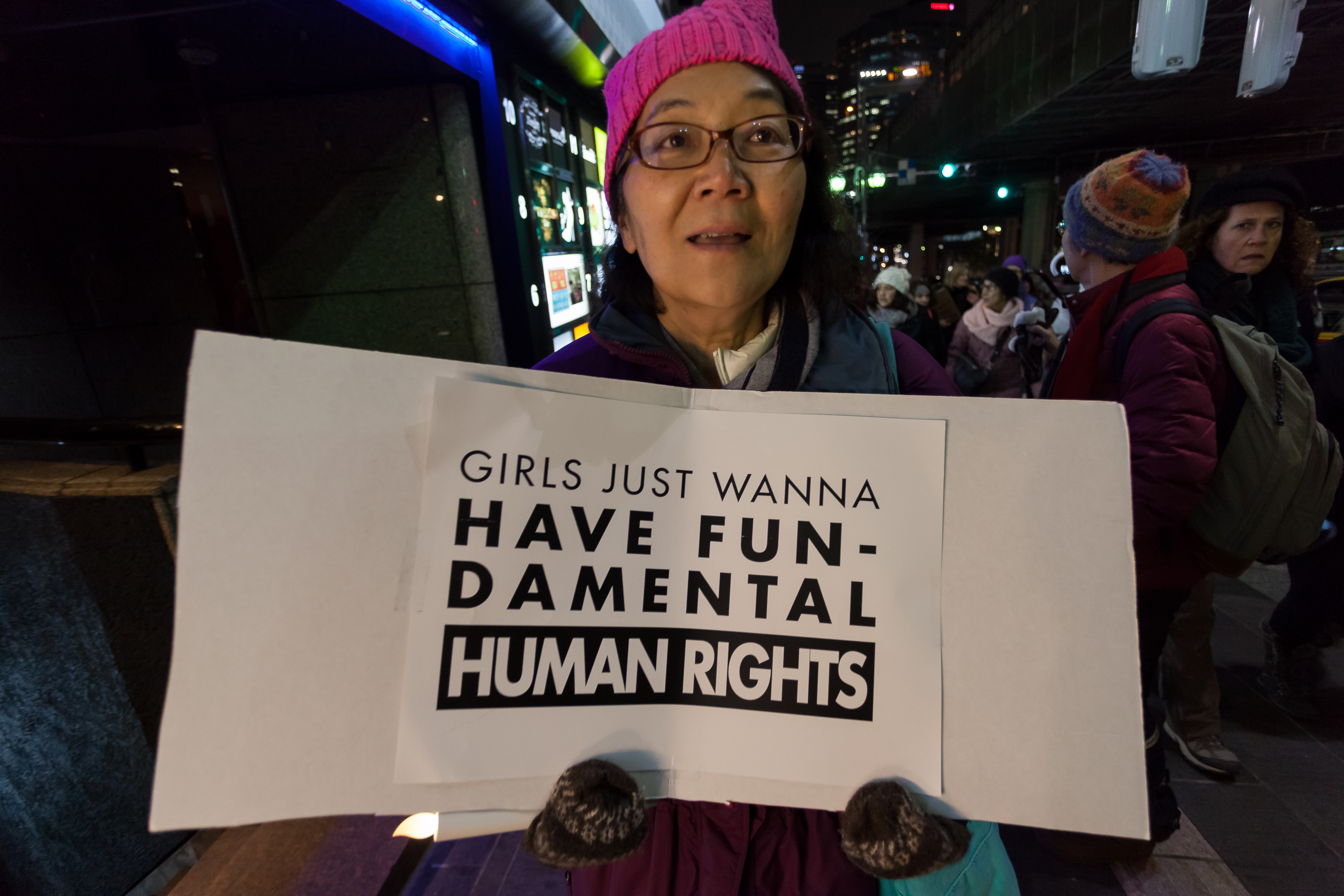 A woman attends a protest march on Jan. 20, 2017 in Tokyo, Japan.