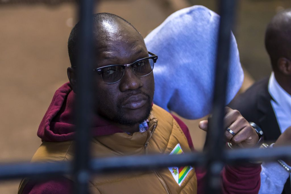 Cleric and activist Evan Mawarire arrives at the magistrate's court in Harare, Zimbabwe on June 28, 2017 after he was detained for praying with striking University of Zimbabwe medical students.