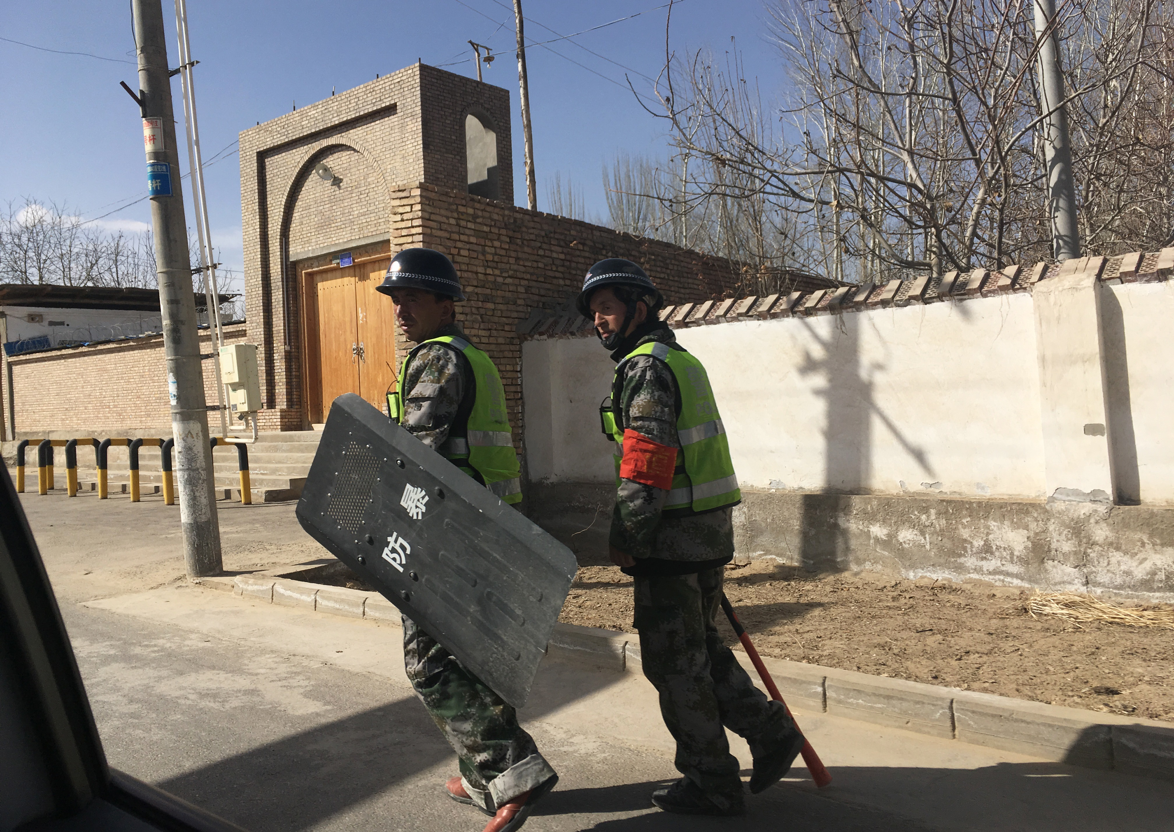 Police patrol a village in Hotan prefecture, in China's western Xinjiang region on Feb. 17, 2018.