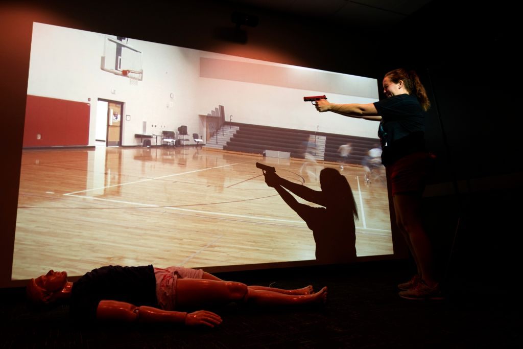 A teacher takes part in an active shooter drill during a firearms course for teachers and administrators in Commerce City, Colorado on June 28, 2018.