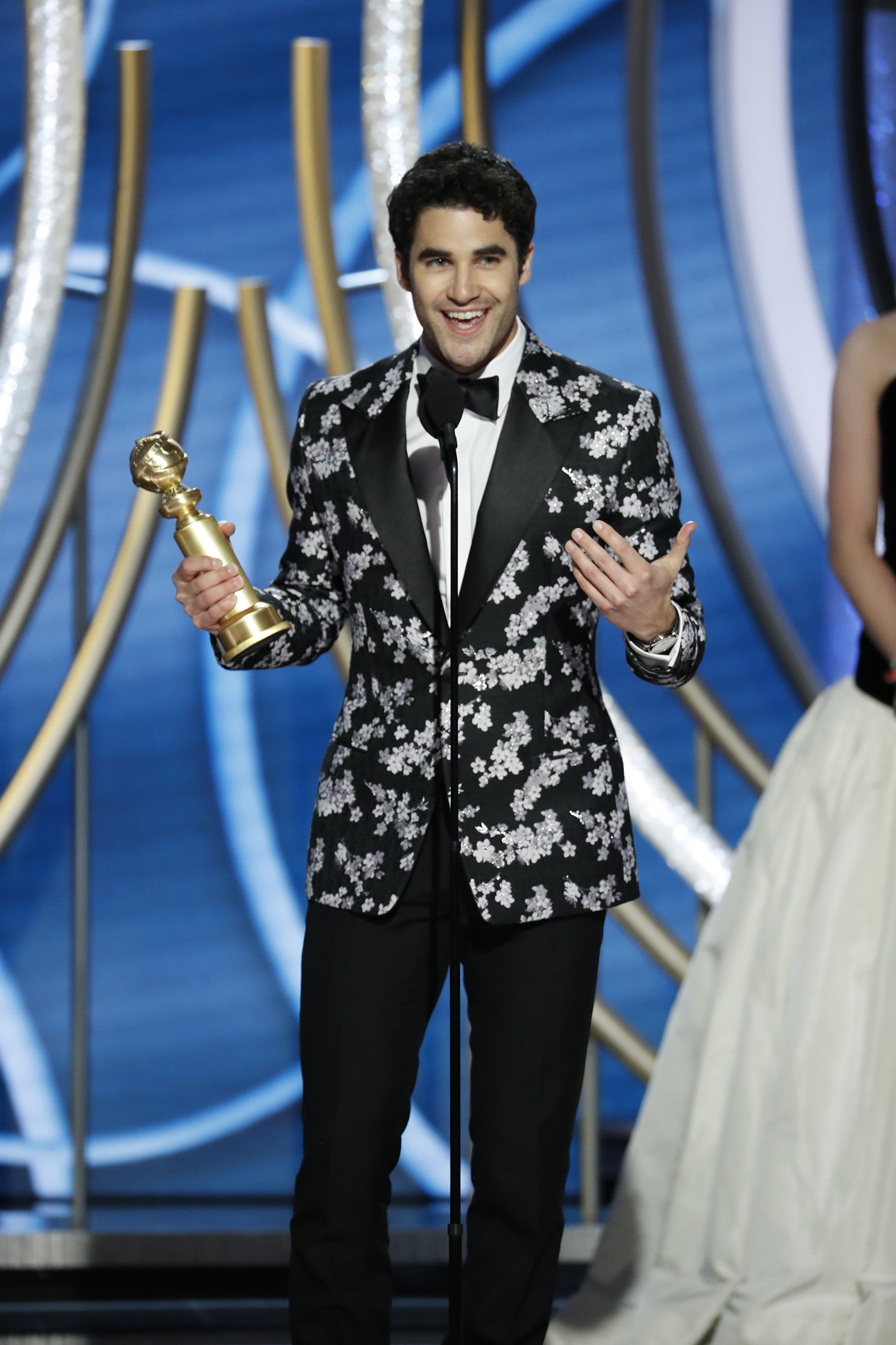 "Darren Criss from ""The Assassination of Gianni Versace: American Crime Story"" accepts the Best Performance by an Actor in a Limited Series or Motion Picture Made for Television award onstage during the 76th Annual Golden Globe Awards."