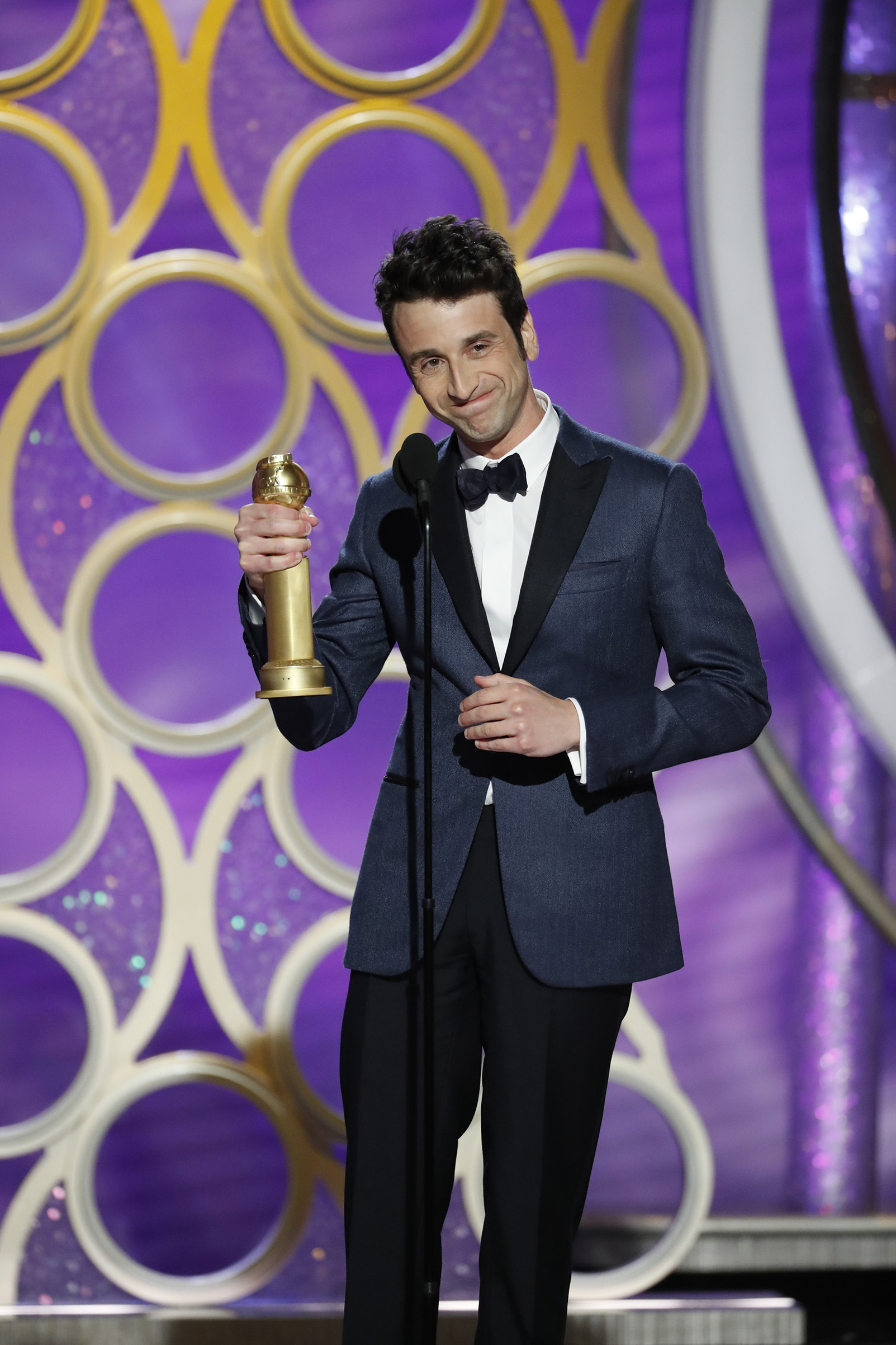 "Justin Hurwitz from ""First Man"" accepts the Best Original Score - Motion Picture award onstage during the 76th Annual Golden Globe Awards."
