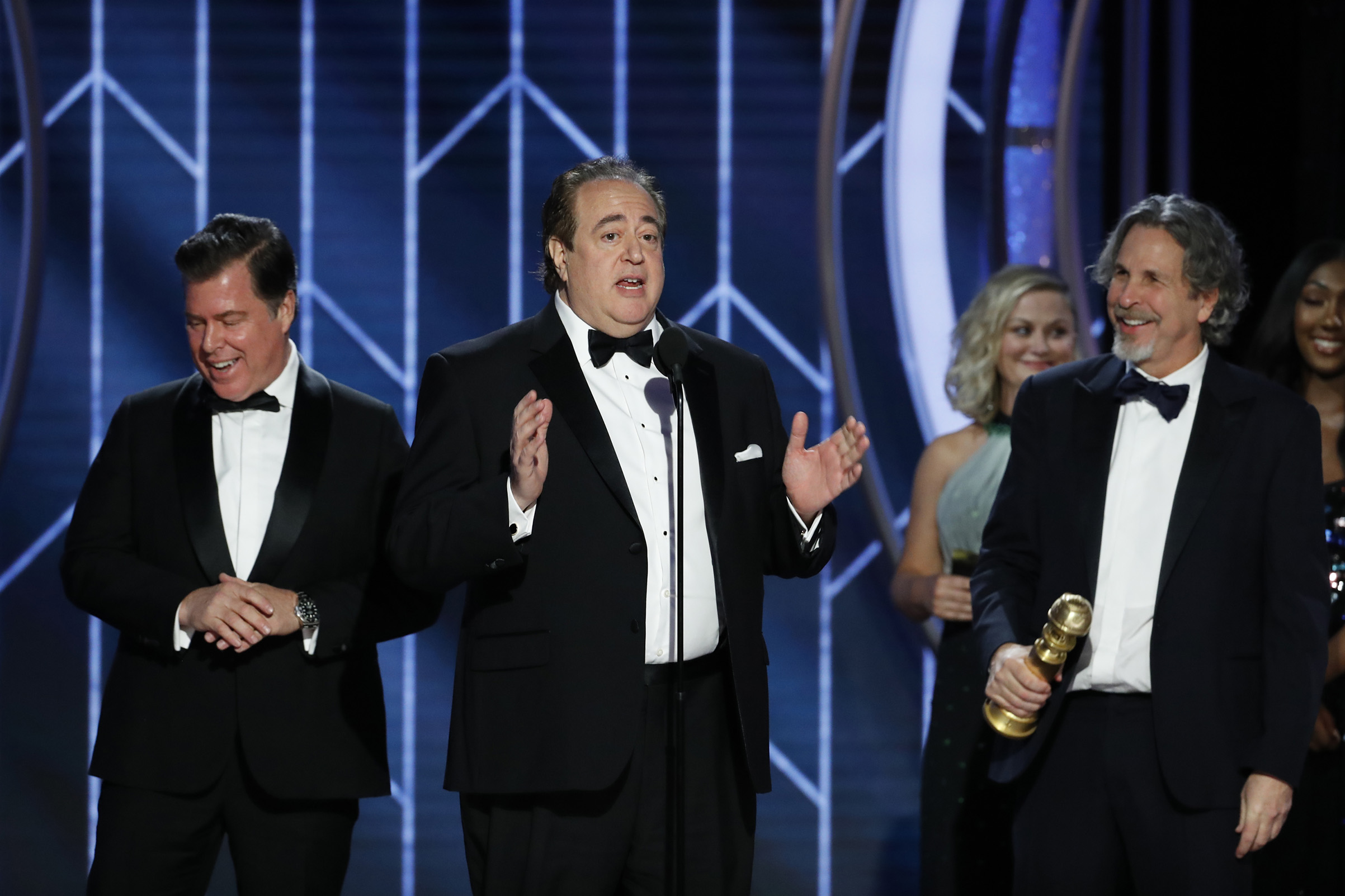 "Brian Currie, Nick Vallelonga and Peter Farrelly of ""Green Book"" accept the Best Screenplay – Motion Picture award onstage during the 76th Annual Golden Globe Awards."