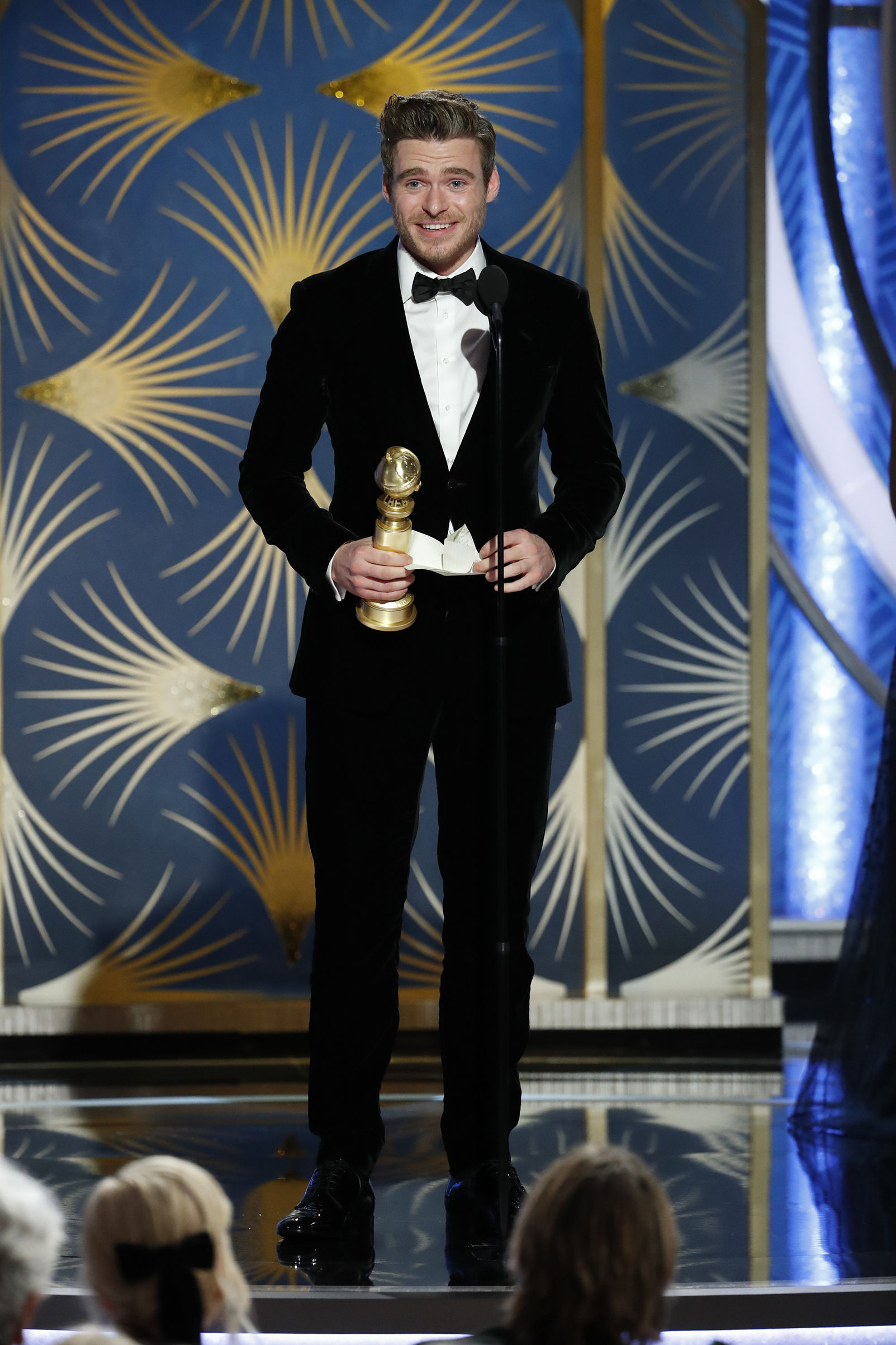 "Richard Madden from ""Bodyguard"" accepts the Best Performance by an Actor in a Television Series – Drama award onstage during the 76th Annual Golden Globe Awards."