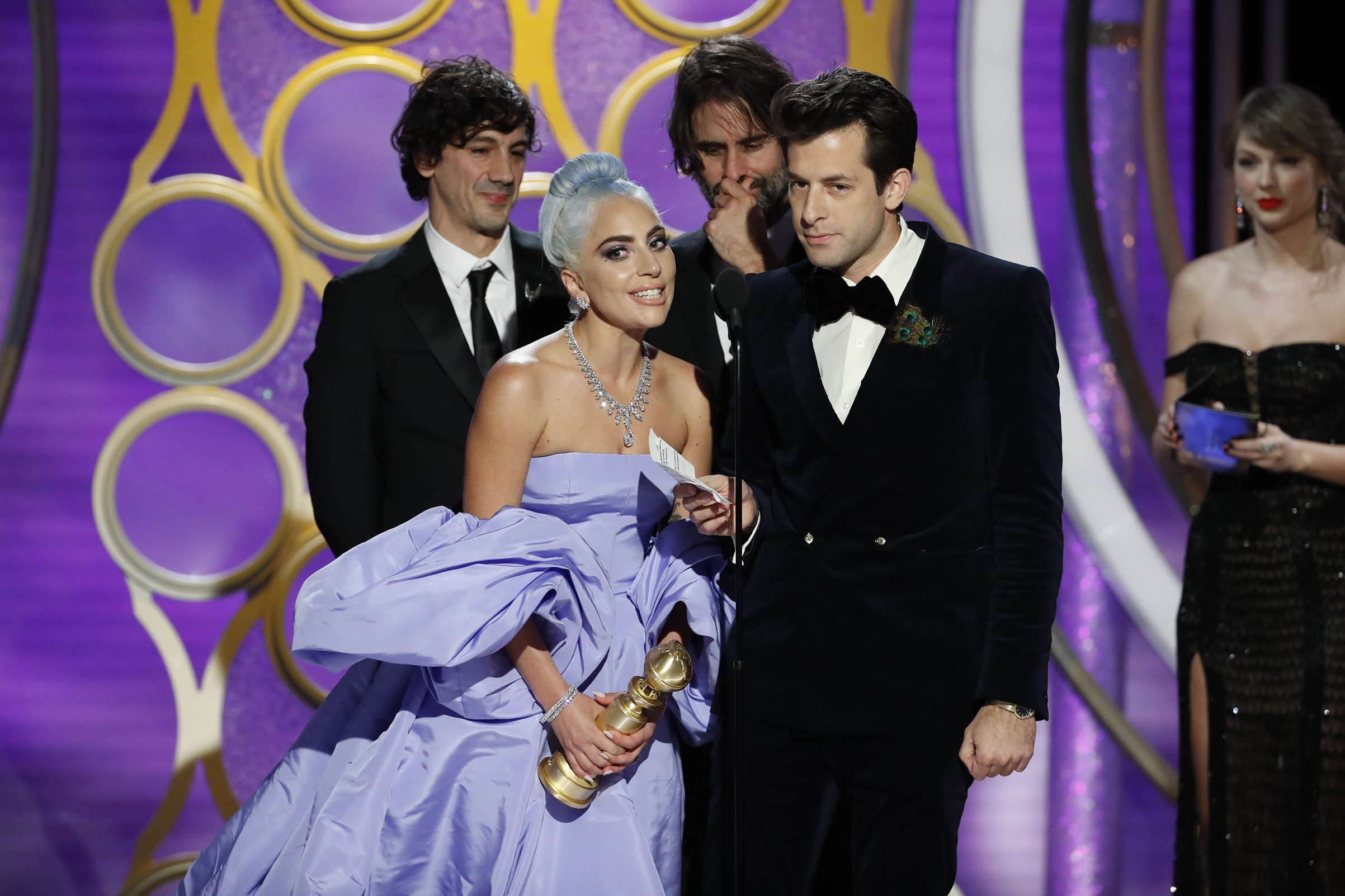 "Lady Gaga and Mark Ronson accept the Best Original Song - Motion Picture awards for ""Shallow"" from ""A Star Is Born"" onstage during the 76th Annual Golden Globe Awards."