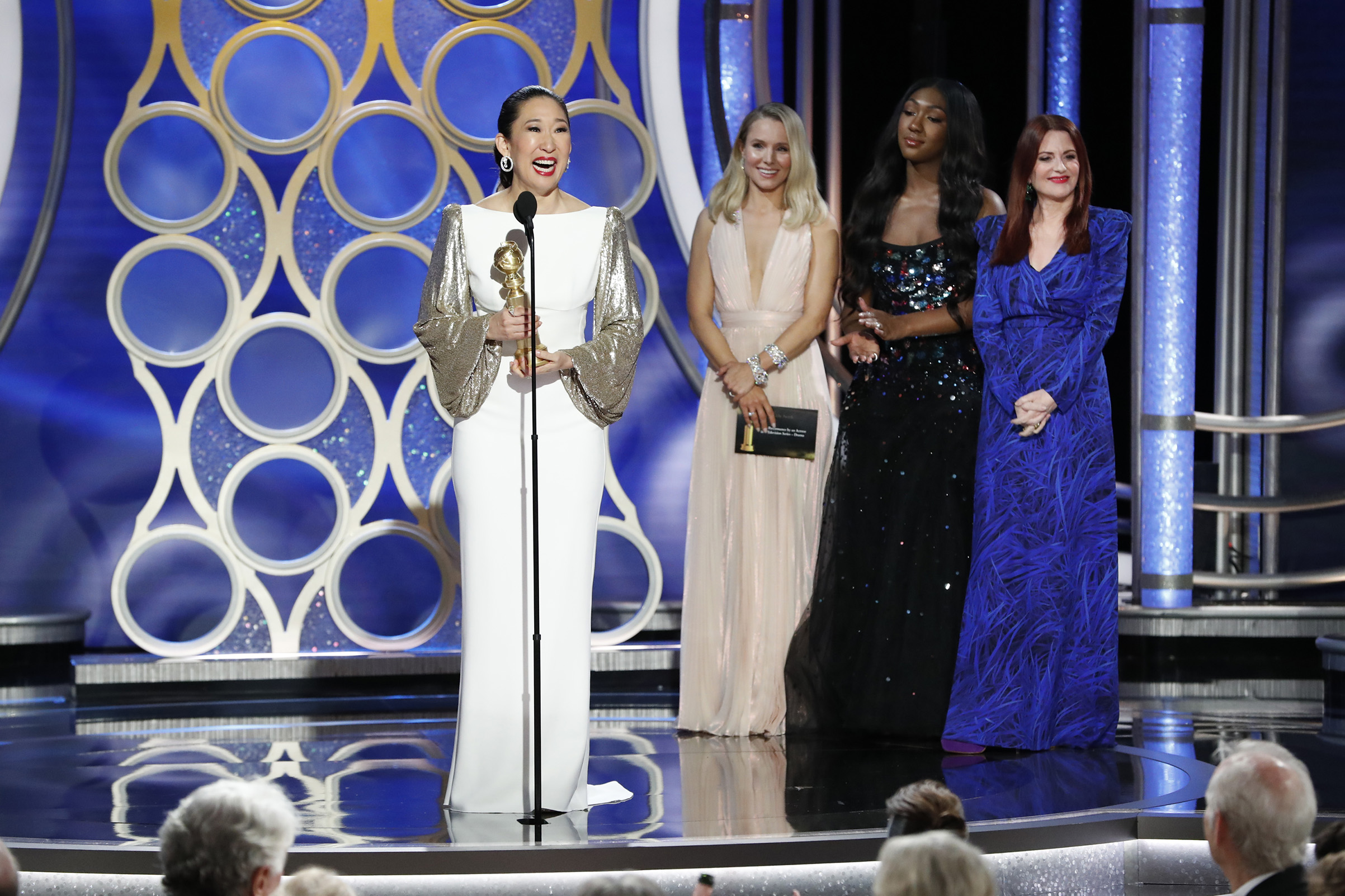 "Sandra Oh from ""Killing Eve"" accept the Best Performance by an Actress in a Television Series – Drama award onstage during the 76th Annual Golden Globe Awards."