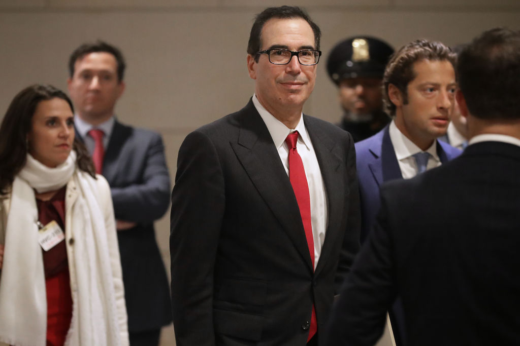 U.S. Treasury Secretary Steven Mnuchin arrives with his Chief of Staff Eli Miller for a classified briefing with a group of bipartisan members of Congress on Jan. 10, 2019 in Washington, DC. If the government shutdown continues it could impact America's credit rating.