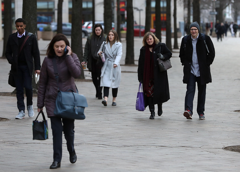 Commuters walk along Pennsylvania Ave on January 28, 2019 in Washington, DC.