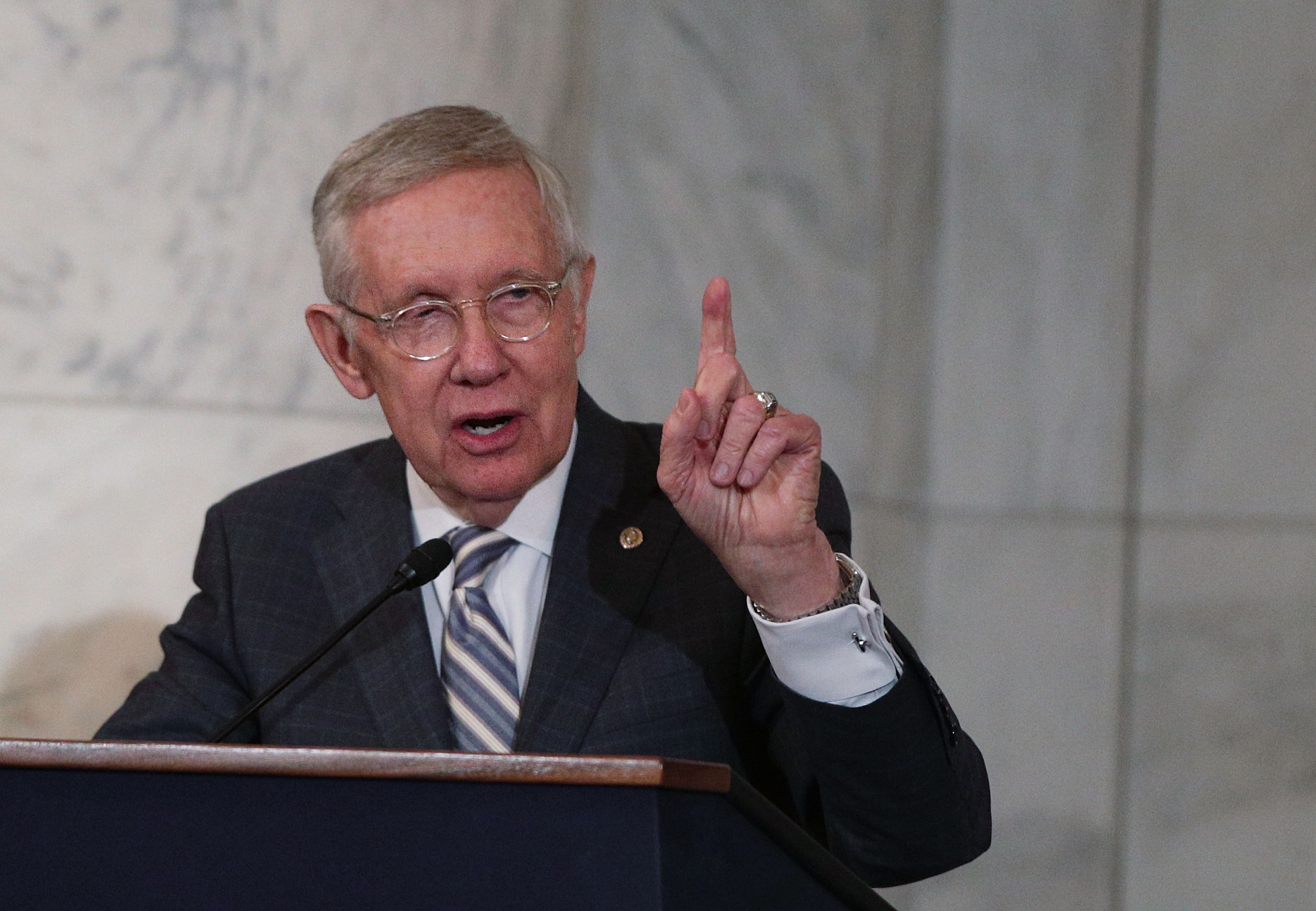 Then-U.S. Senate Minority Leader Sen. Harry Reid (D-NV) speaks during his leadership portrait unveiling ceremony December 8, 2016 on Capitol Hill in Washington, DC.
