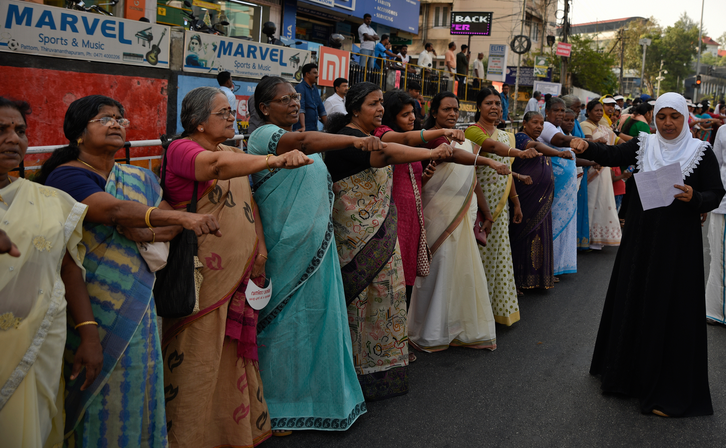 Women stand shoulder to shoulder as part of a  women's wall  in Thiruvananthapuram, in the southern Indian state of Kerala, on Jan. 1, 2019.