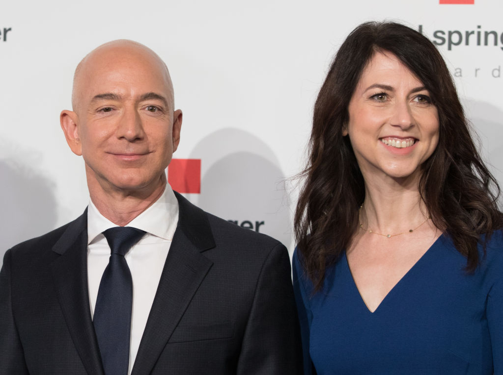 Head of Amazon Jeff Bezos and his wife MacKenzie Bezos arrive for the Axel Springer award ceremony in Berlin, Germany on April 24, 2018. The couple announced their plans to divorce on Wednesday morning.