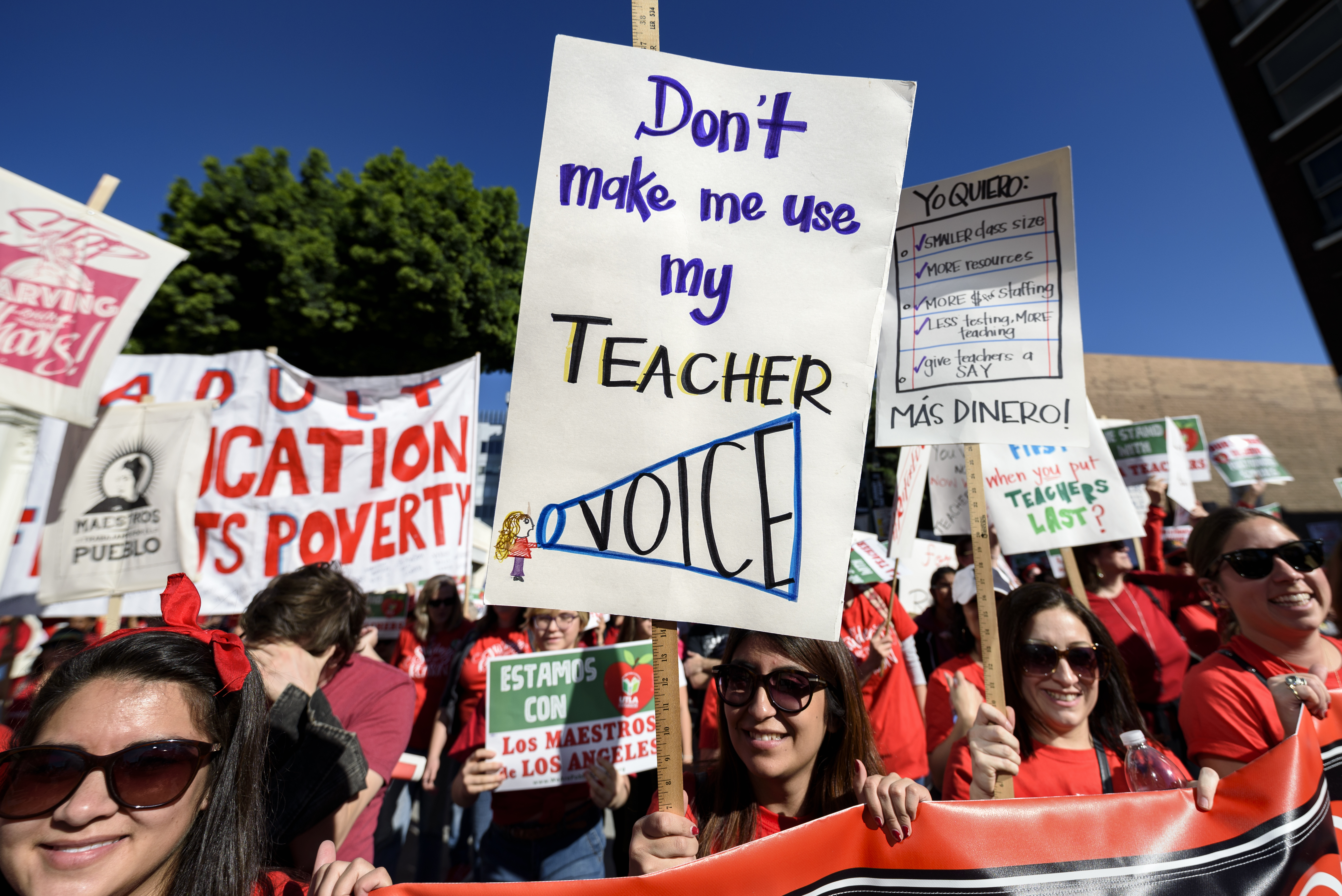 Teachers and supporters of public education march against education funding cuts during the March for Public Education in Los Angeles, California on Dec. 15, 2018.