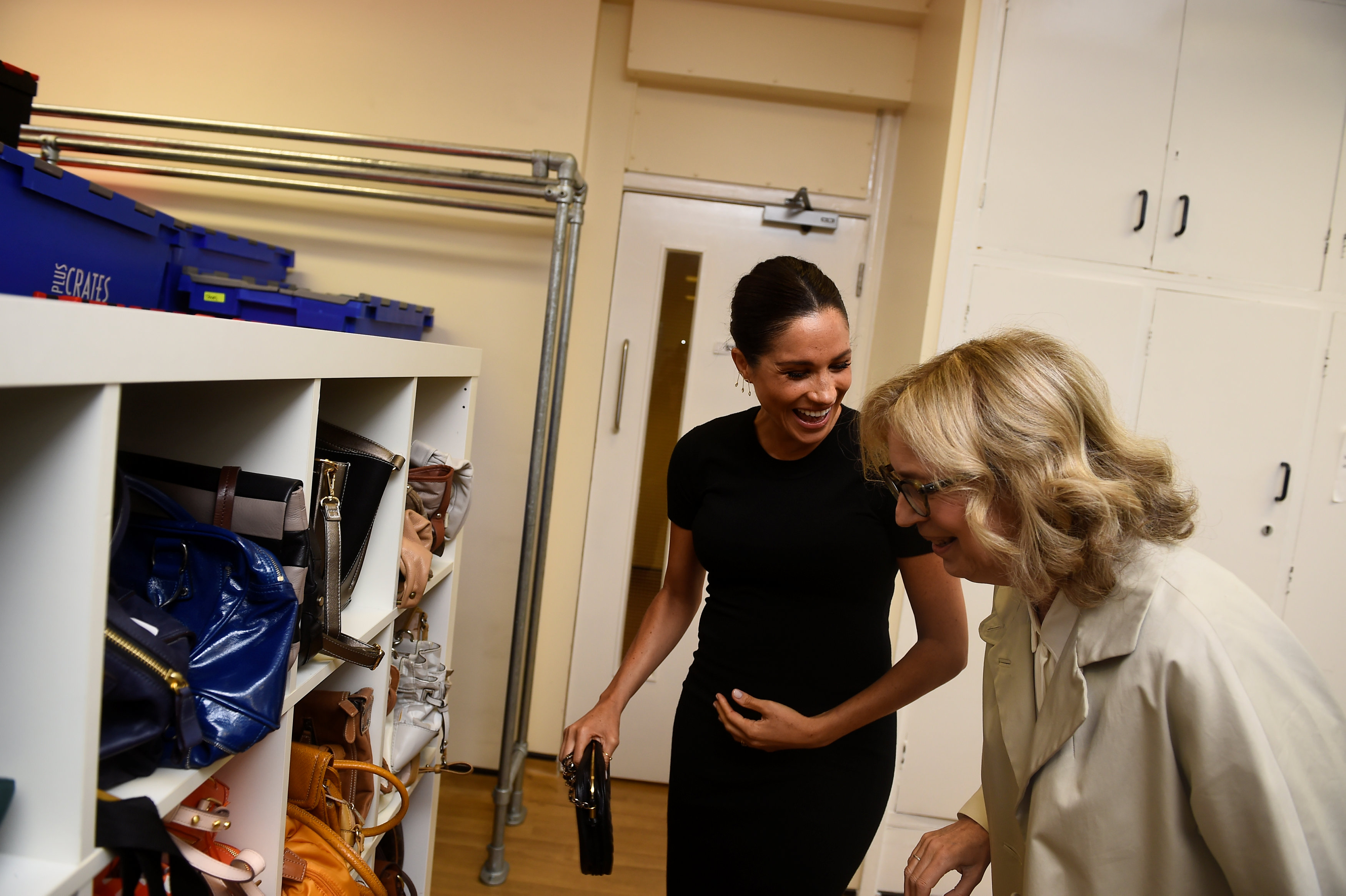 Meghan, Duchess of Sussex reacts as she looks at bags with Lady Juliet Hughes-Hallett during her visit to Smart Works on January 10, 2019 in London, United Kingdom. Smart Works is one of the four organizations which she has become Royal Patron of it was announced today by Kensington Palace. The three other organisations are The National Theatre, The Association of Commonwealth Universities (ACU) and Mayhew. (Photo by Clodagh Kilcoyne - WPA Pool/Getty Images)