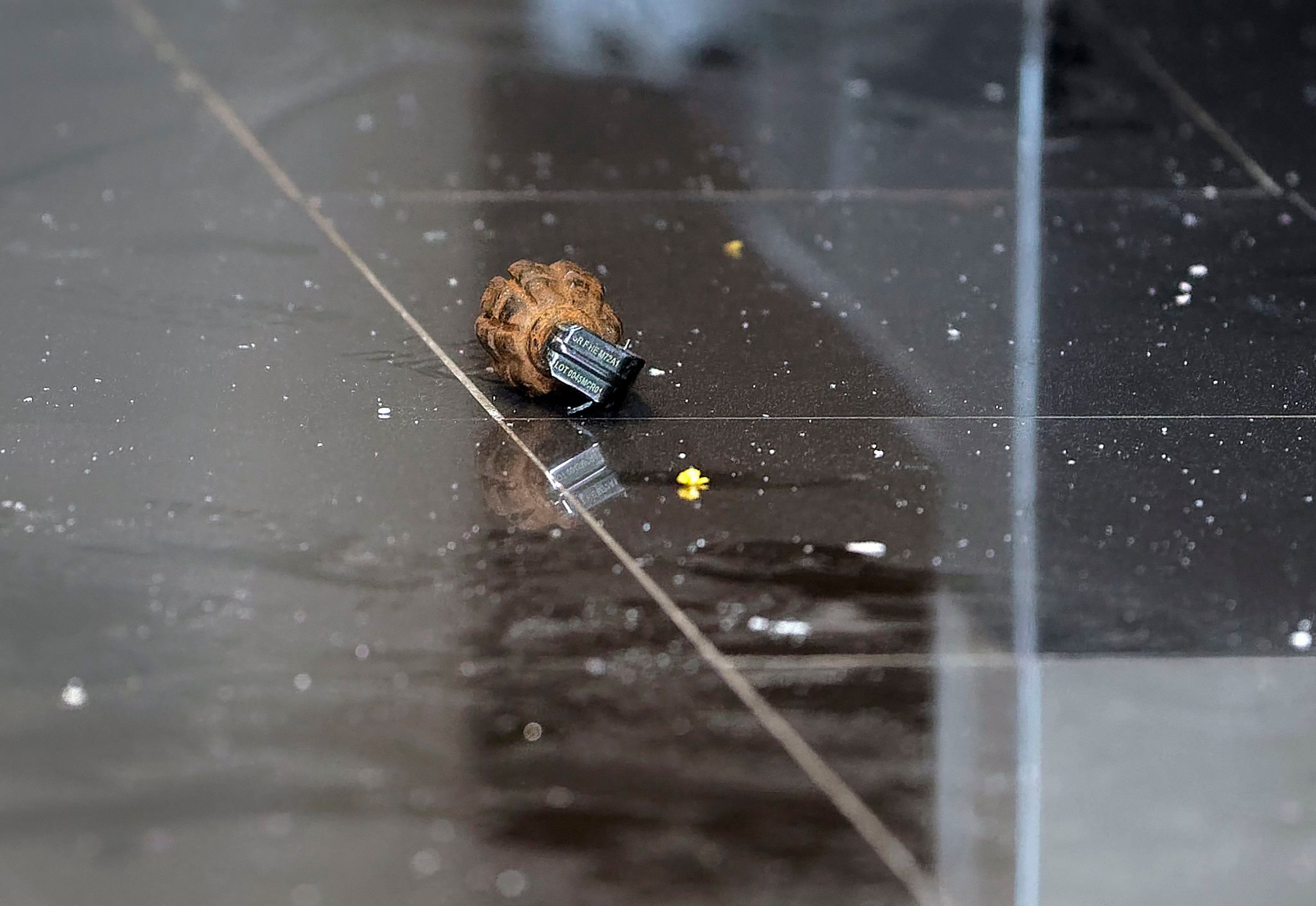 An unexploded grenade lies in a hallway of an upscale hotel complex.