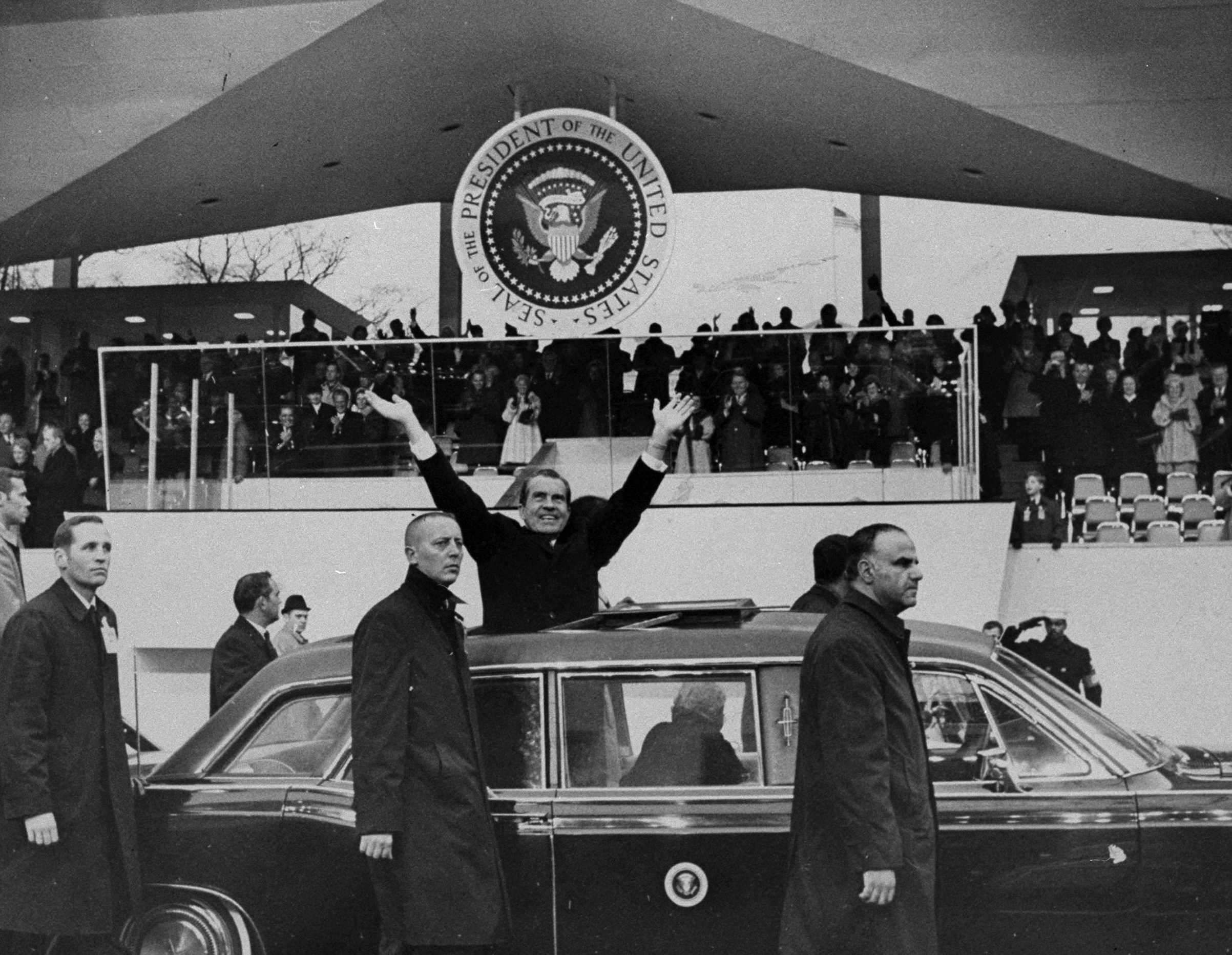 President Richard Nixon stands in car during the inaugural parade on Jan. 20, 1969.