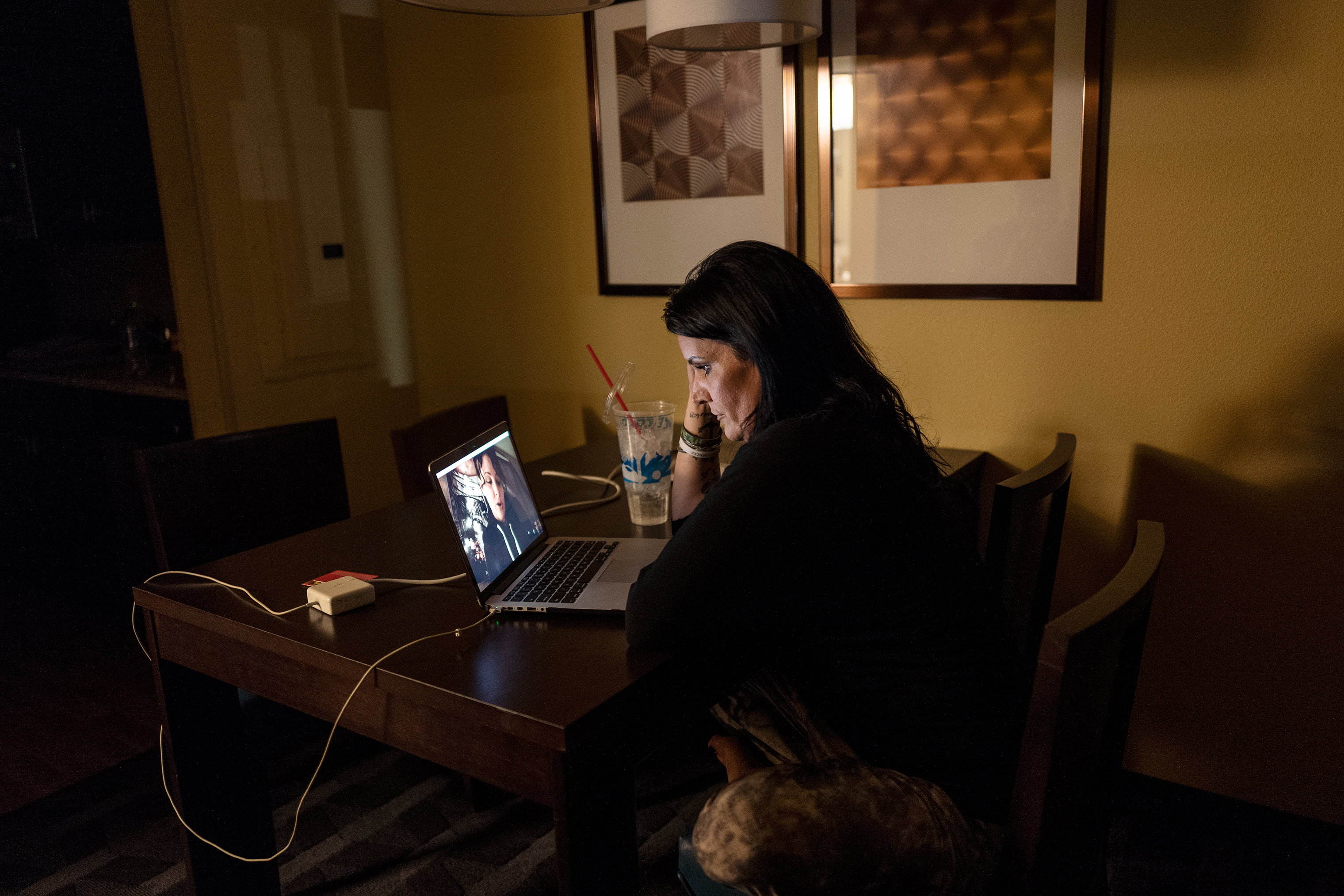 From her hotel room in North Dakota, Lazenko speaks with Adale, a human trafficking survivor in Utah, over Skype. Lazenko spends hours every day remotely helping women all over the US.