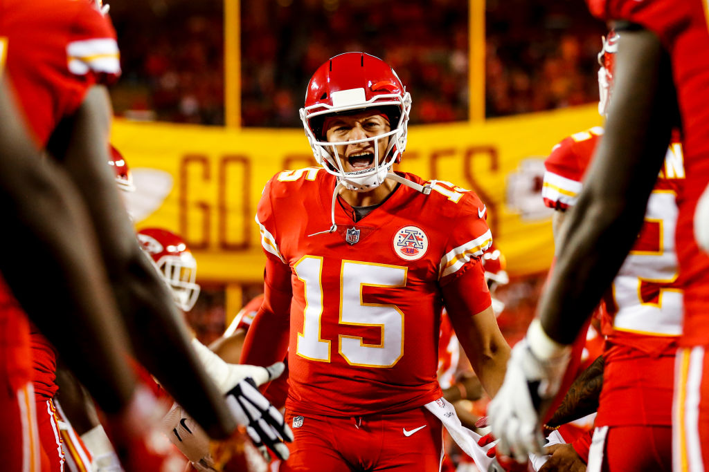 Patrick Mahomes #15 of the Kansas City Chiefs runs through high fives from teammates during pre game introductions prior to the game against the Cincinnati Bengals at Arrowhead Stadium on October 21, 2018 in Kansas City, Kansas.
