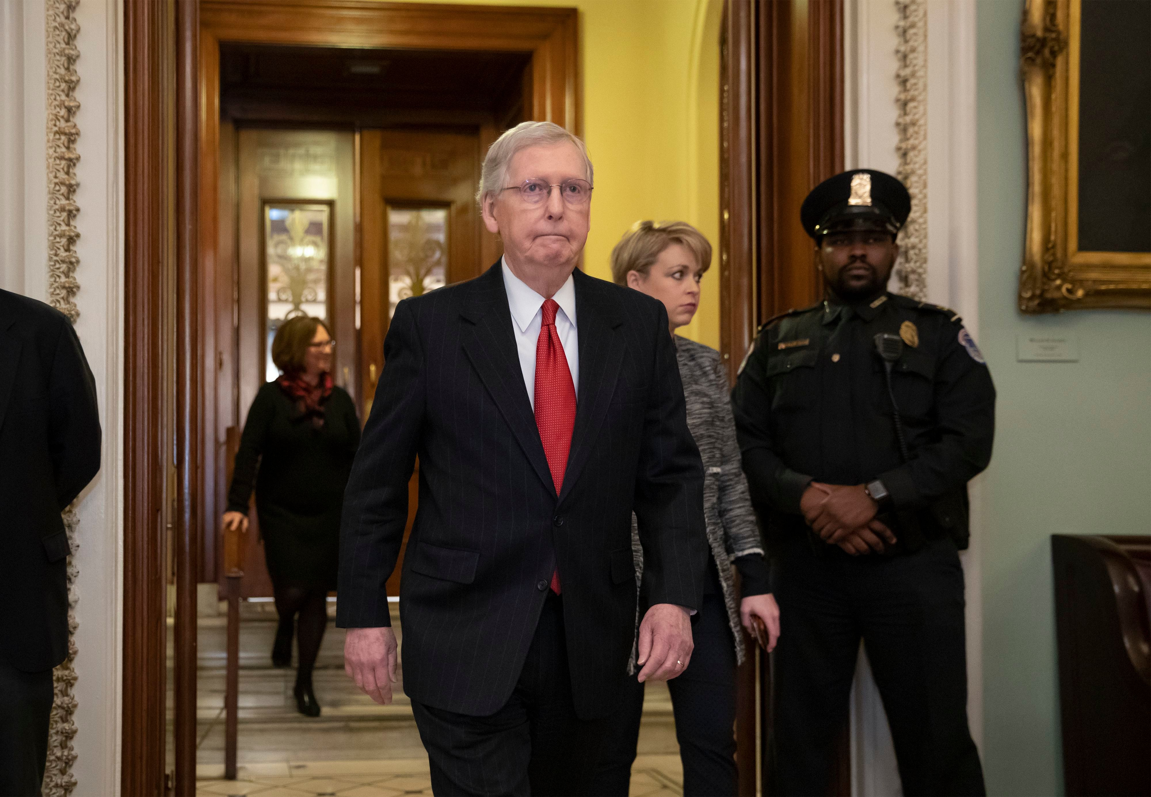 Senate Majority Leader Mitch McConnell steps out of the chamber prior to a vote on ending the partial government shutdown, at the Capitol in Washington, D.C. on Jan. 24, 2019.