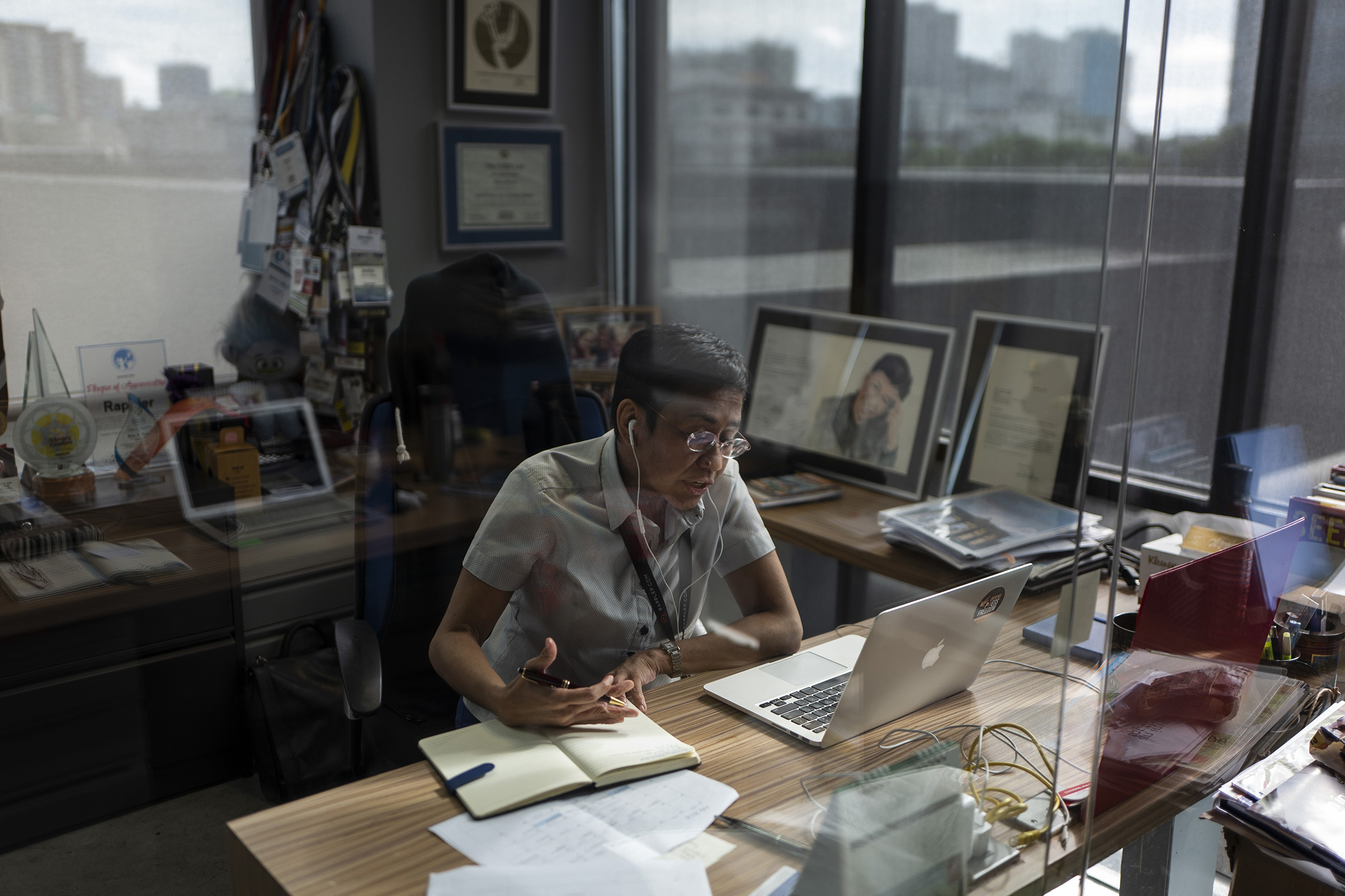 The writer in her office at Rappler in Manila