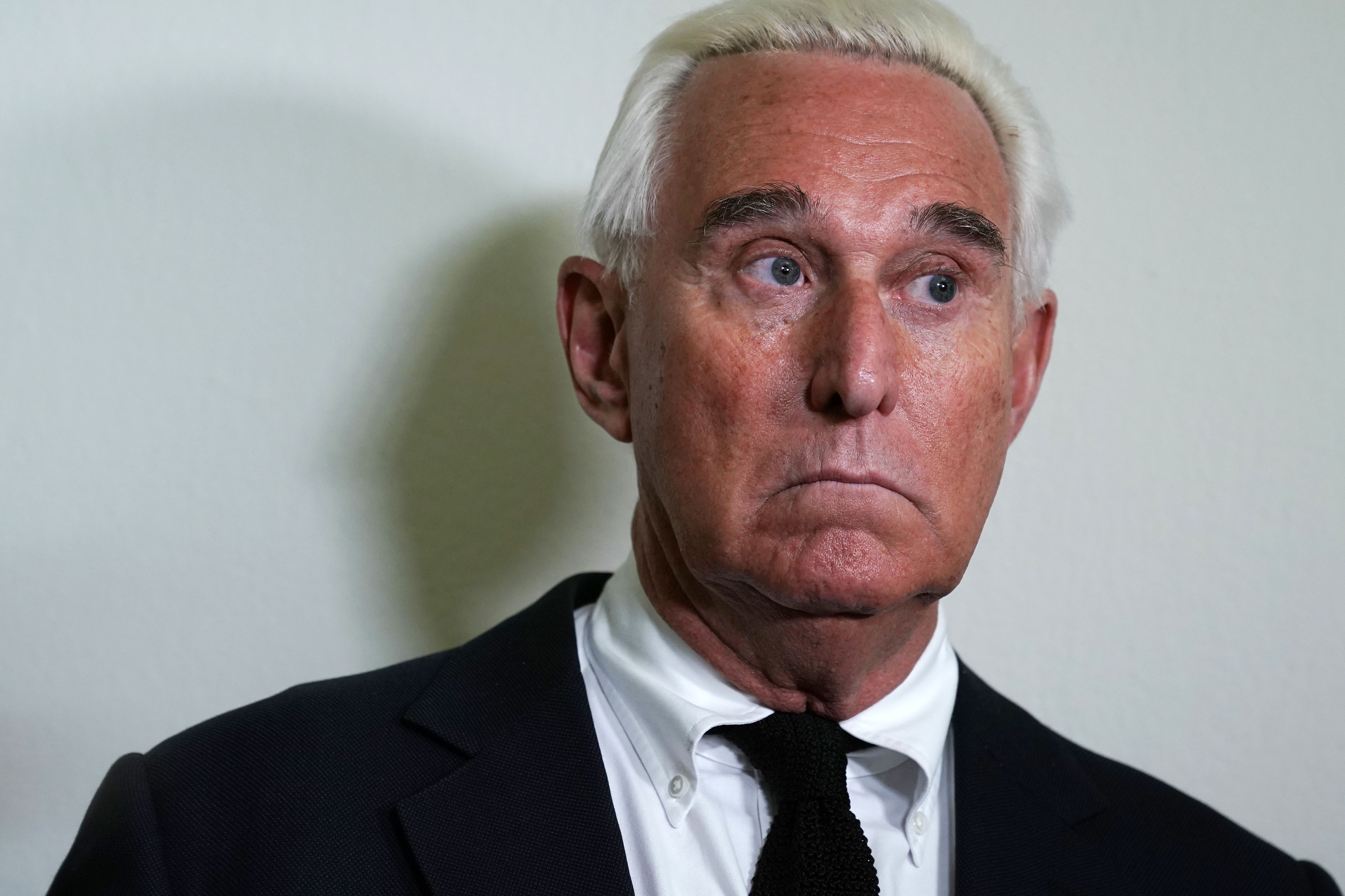 Longtime informal adviser to President Trump Roger Stone speaks to cameras outside a hearing where Google CEO Sundar Pichai testified before the House Judiciary Committee at the Rayburn House Office Building on December 11, 2018 in Washington, DC.