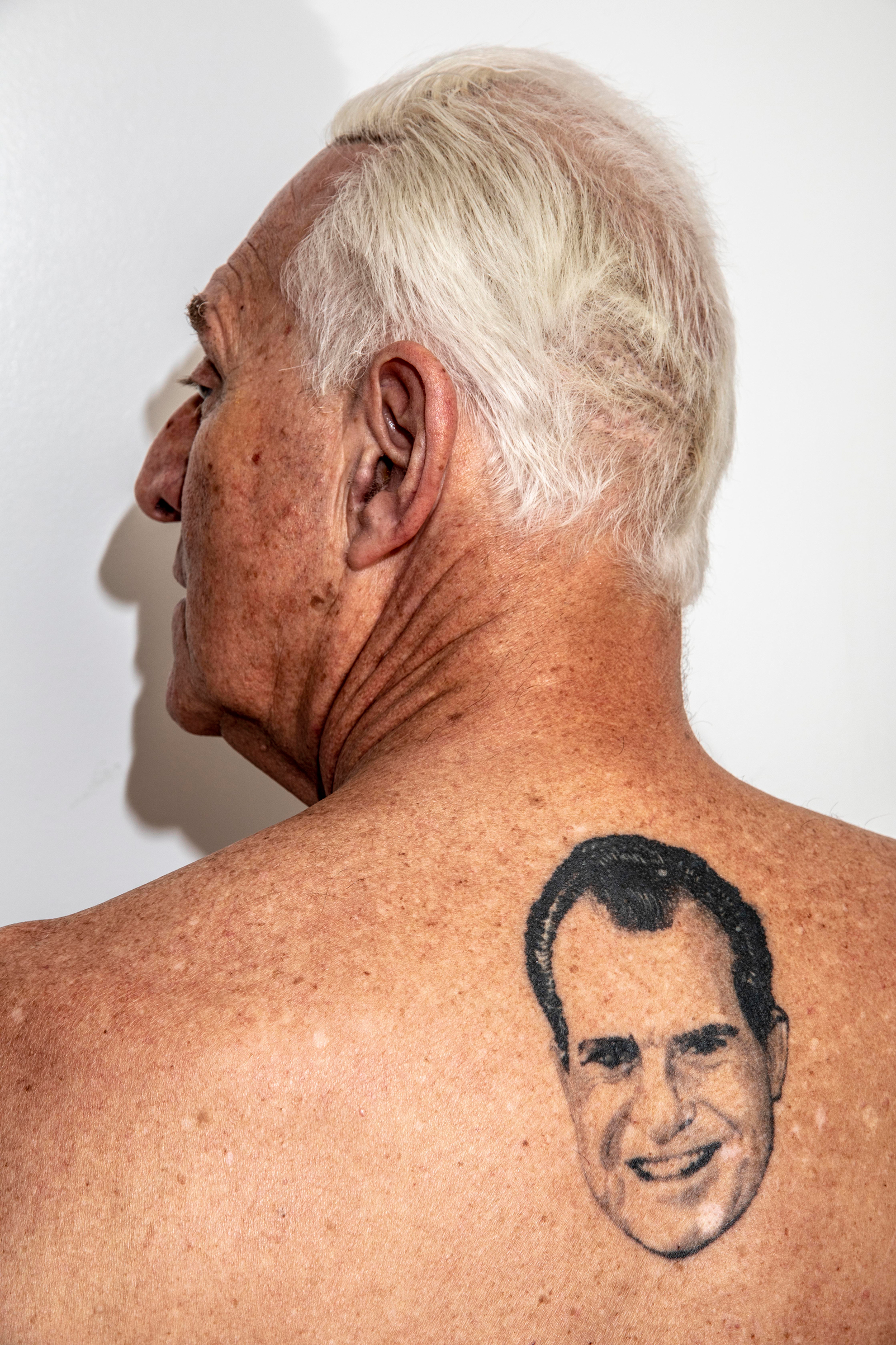 Stone shows off his Richard Nixon tattoo at his apartment in New York in June 2018.