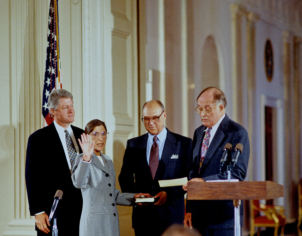 Ruth Bader Ginsberg is sworn in as Associate Justice of the Supreme Court of the United States, as President Bill Clinton stands behind her and her husband, Martin, holds the bible in 1993.