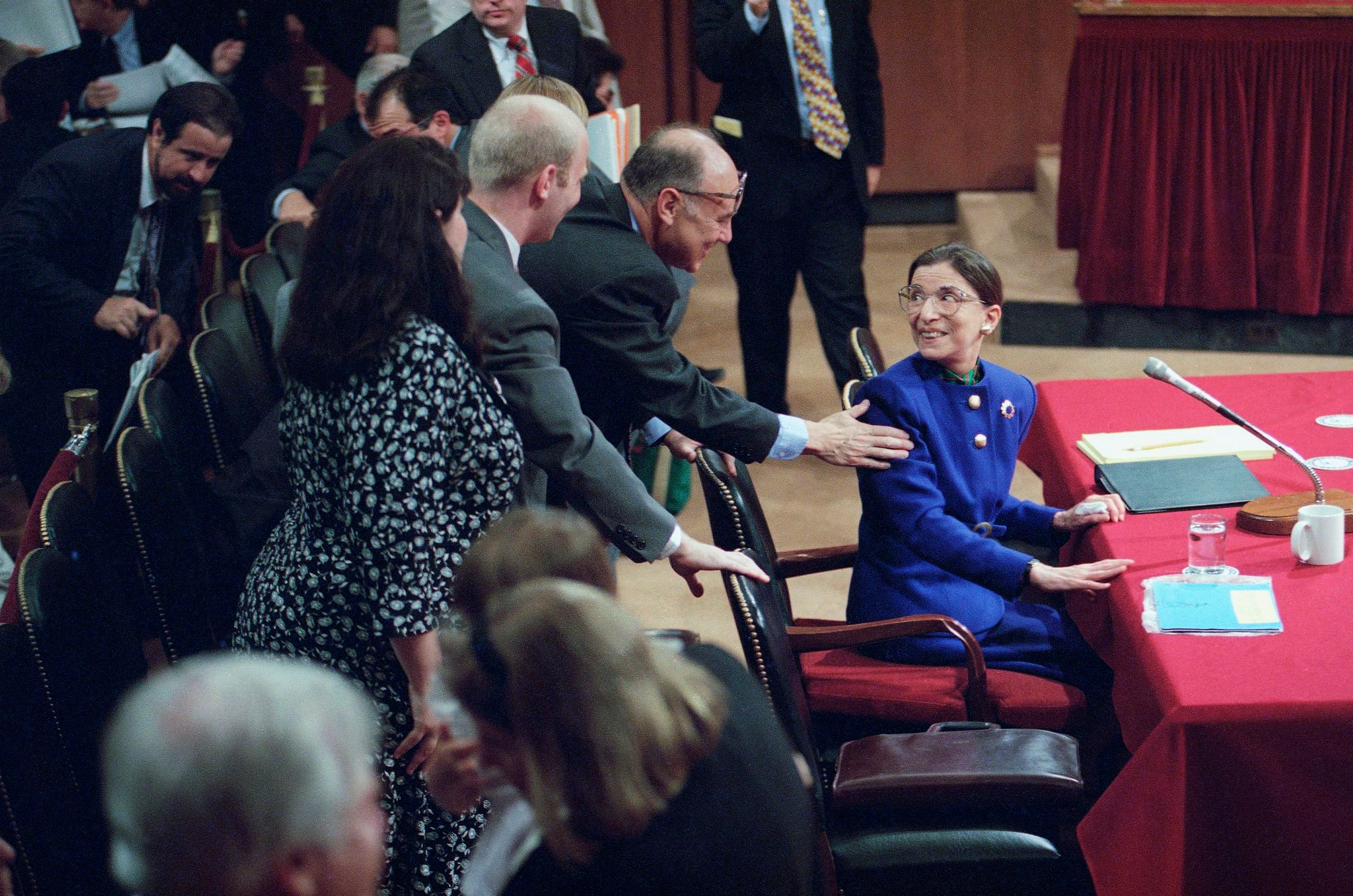 Judge Ruth Bader Ginsburg, then a Supreme Court nominee, is greeted by her husband, Martin, as she introduced her family during her confirmation hearing before the Senate Judiciary Committee on Capitol Hill in Washington on July 20, 1993.