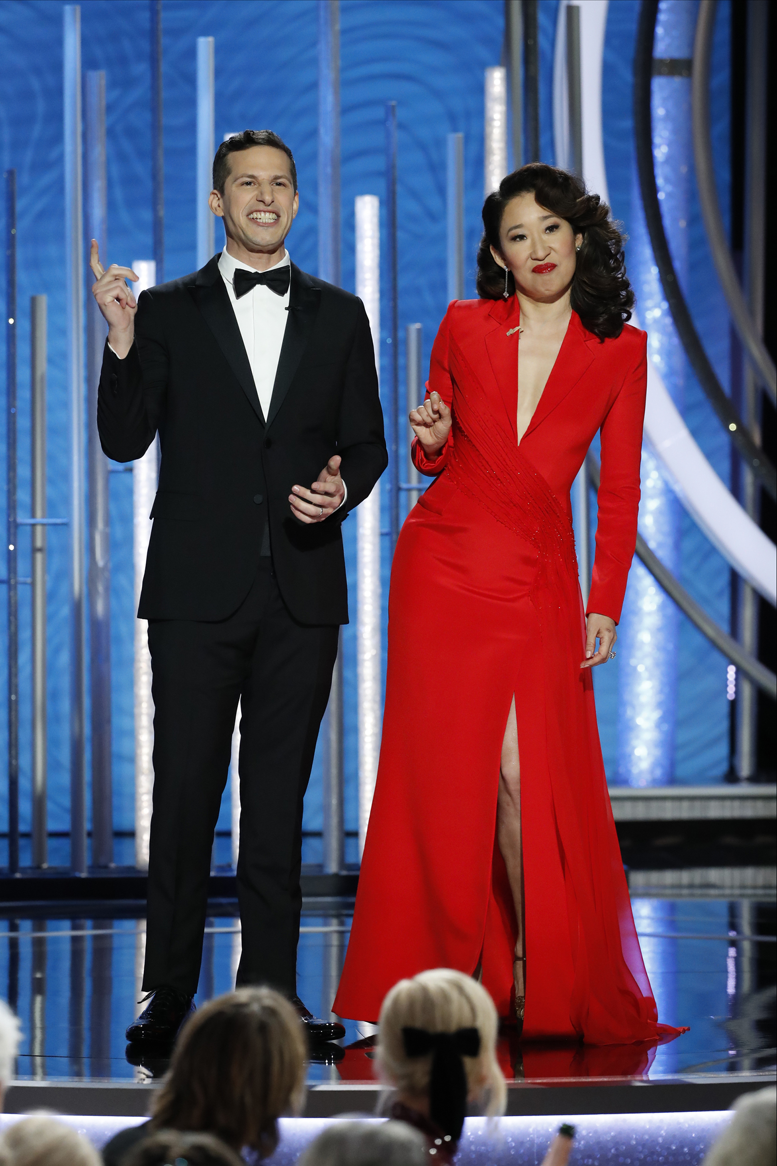 Hosts Andy Samberg and Sandra Oh  speak onstage during the 76th Annual Golden Globe Awards.