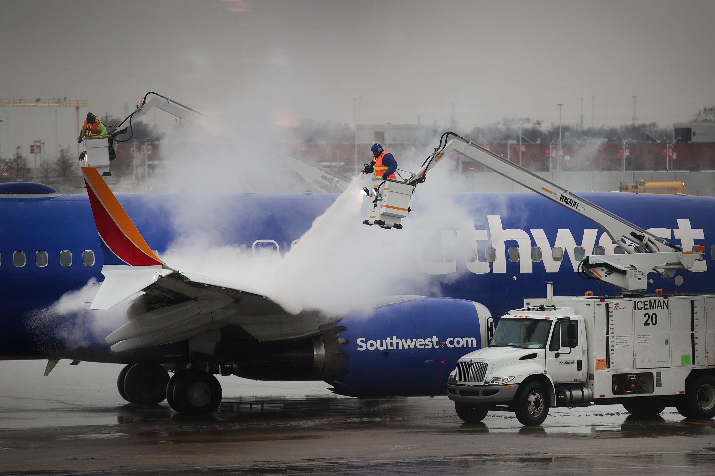Workers deice a Southwest Airline's aircraft at Midway Airport on January 22, 2019 in Chicago, Illinois.