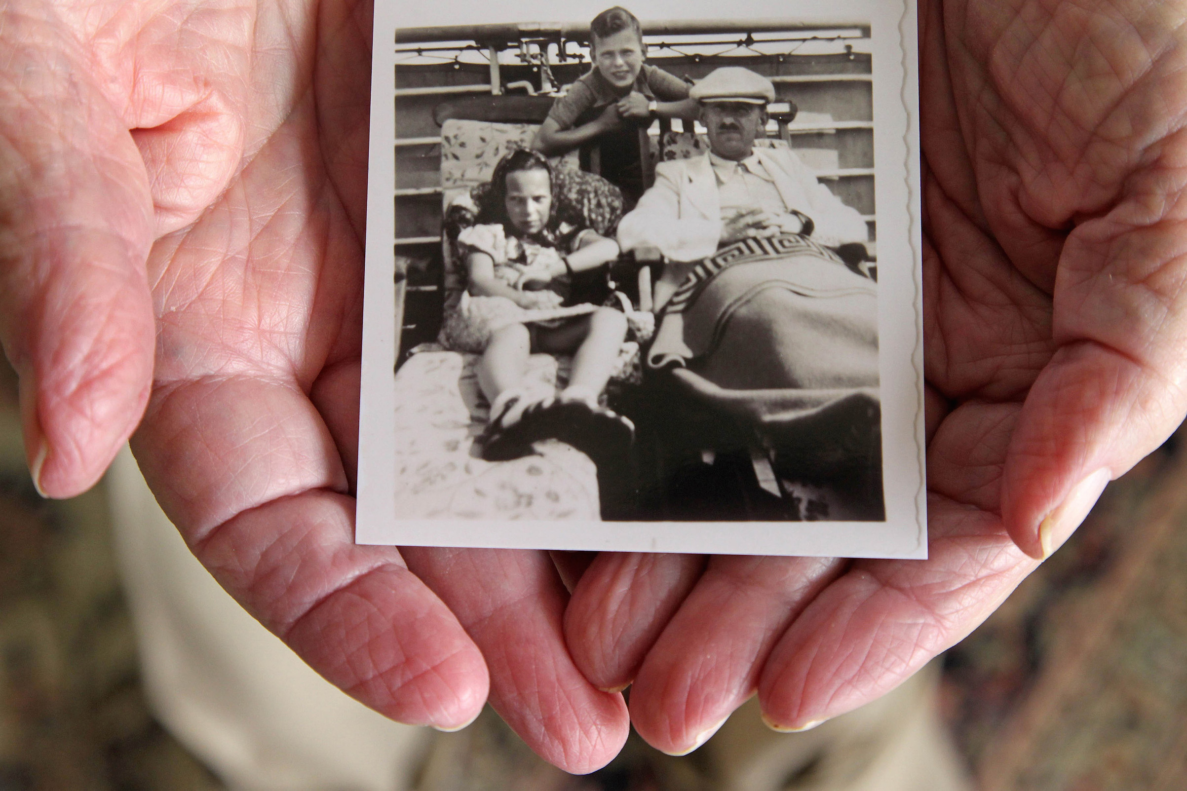 Herbert Karliner, one of the survivors of the 900 Jewish refugees fleeing Hitler who were aboard the ocean liner, St. Louis, in 1939, shares photos and documents from his ordeal on Nov. 18, 2015, in Aventura, Fla.