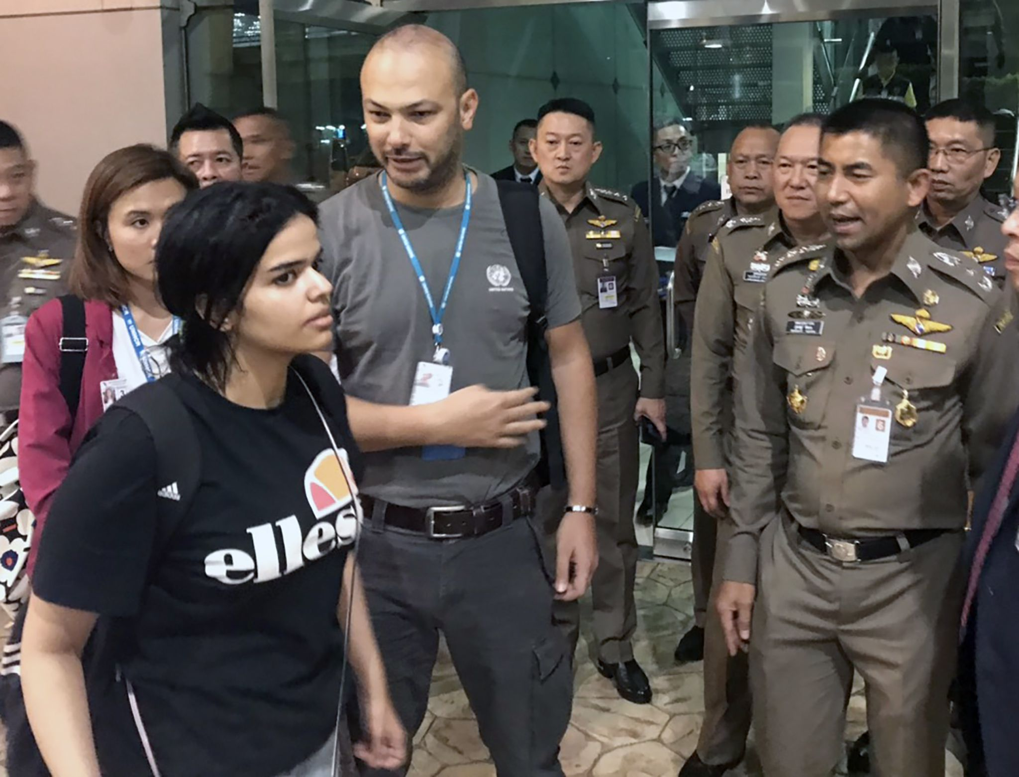 A handout photo made available by the Thai Immigration Bureau shows Saudi woman who seeking for asylum Rahaf Mohammed al-Qunun talks with Thai Immigration Police Chief Surachet Hakparn at the Suvarnabhumi international airport in Samut Prakan province, on the outskirts of Bangkok, Thailand, on Jan. 7, 2019. The Saudi teen was stopped at the airport as she was traveling to Australia for asylum after she claimed that she was abused by her family.