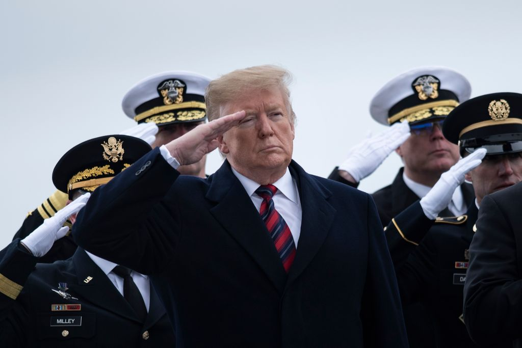 US President Trump and others pay their respects as the remains of Scott A. Wirtz, a Defense Intelligence Agency civilian and former Navy Seal, are carried by during a dignified transfer for US personal killed in a suicide bombing in Syria at Dover Air Force Base on Jan, 19, 2019 in Dover, Delaware.
