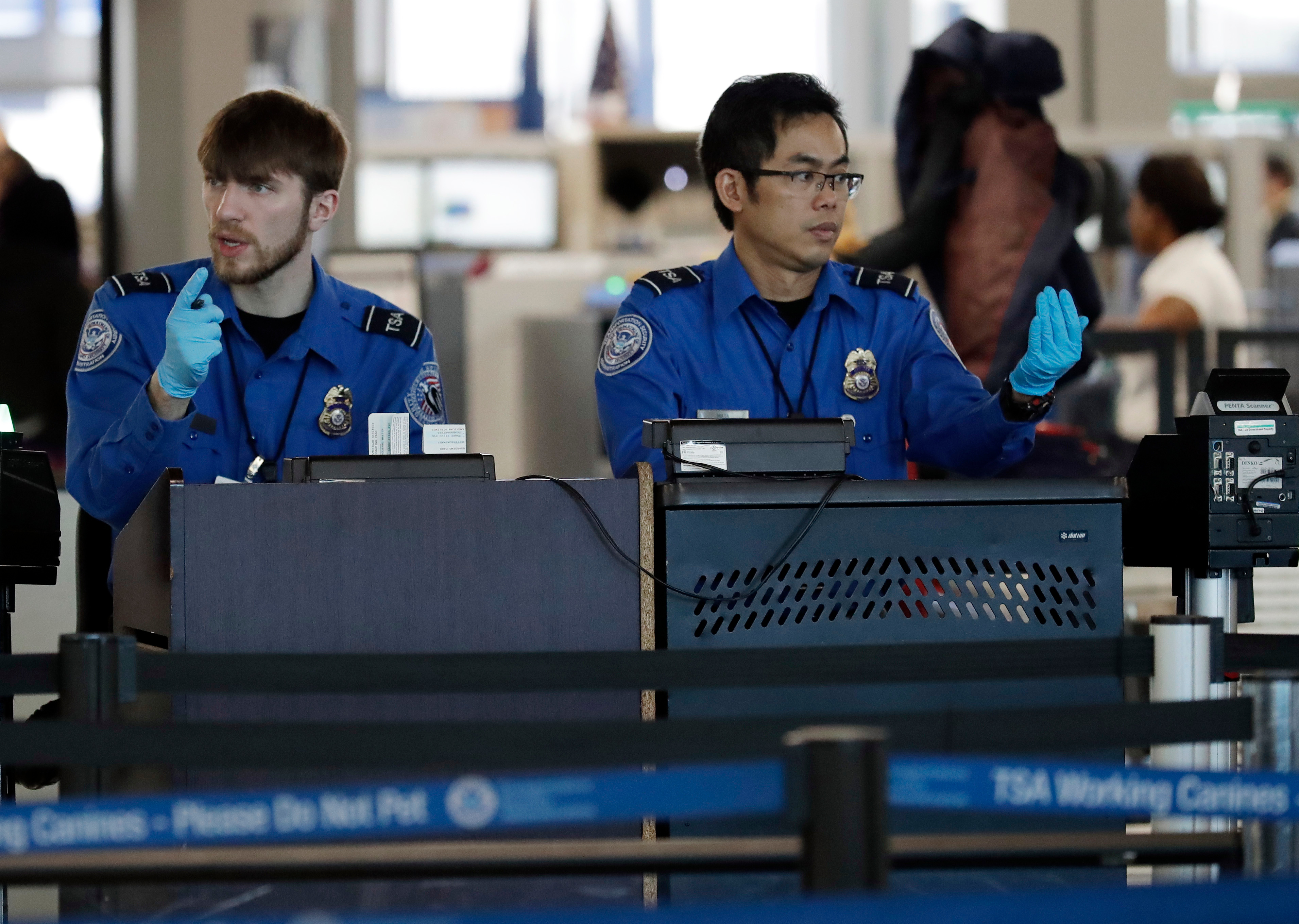 Transportation Security Administration officers work at a checkpoint at O'Hare airport in Chicago, Il. on Jan. 5, 2019.