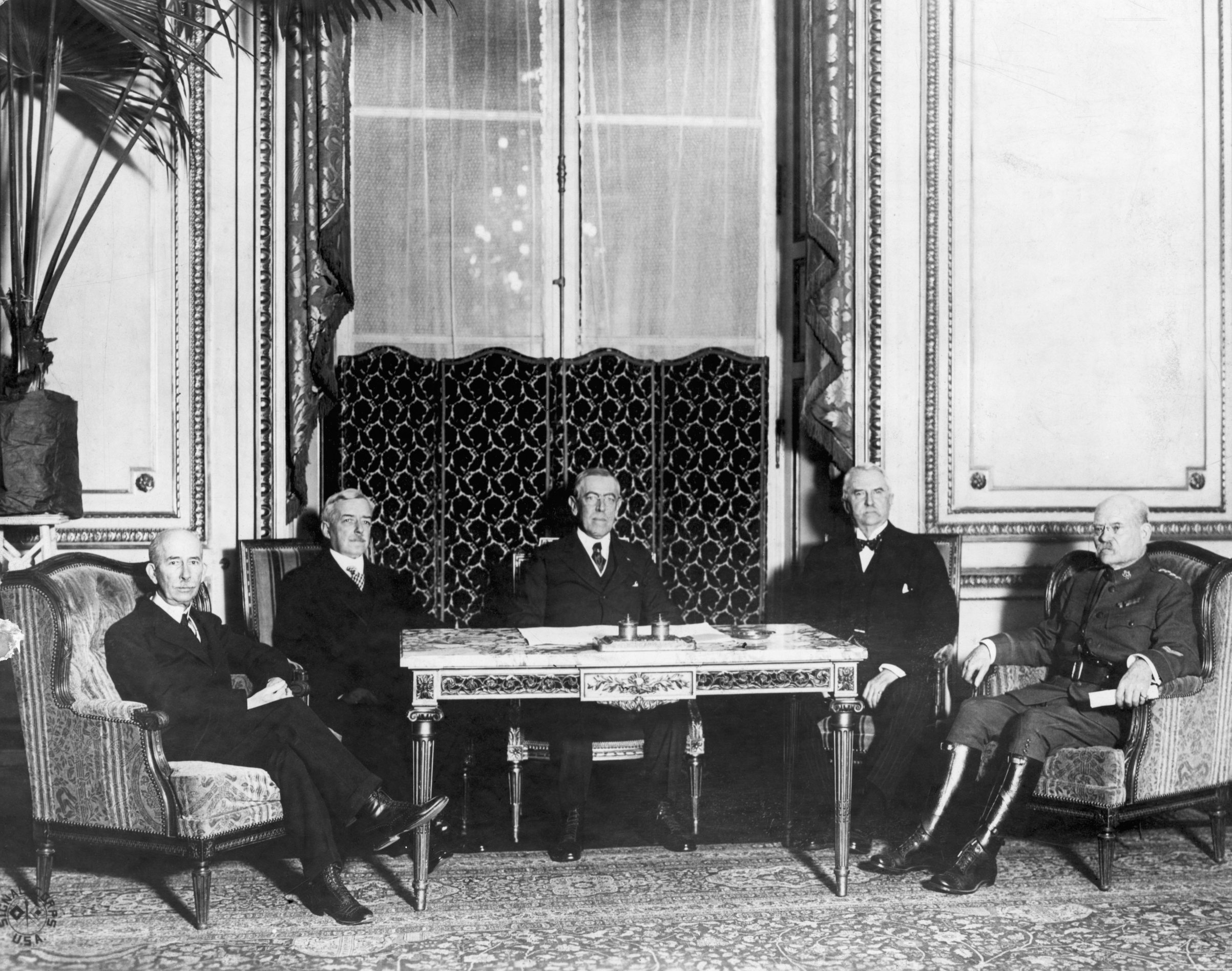 The American delegation at the Versailles Conference. From left to right--House, Lansing, Wilson, Henry White, Gen. Bliss. Undated photograph.