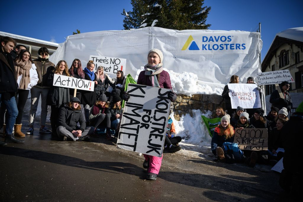 A Swedish climate activist holds a placard during a  School strike for climate  held near the World Economic Forum annual meeting, on Jan. 25, 2019 in Davos, Switzerland.
