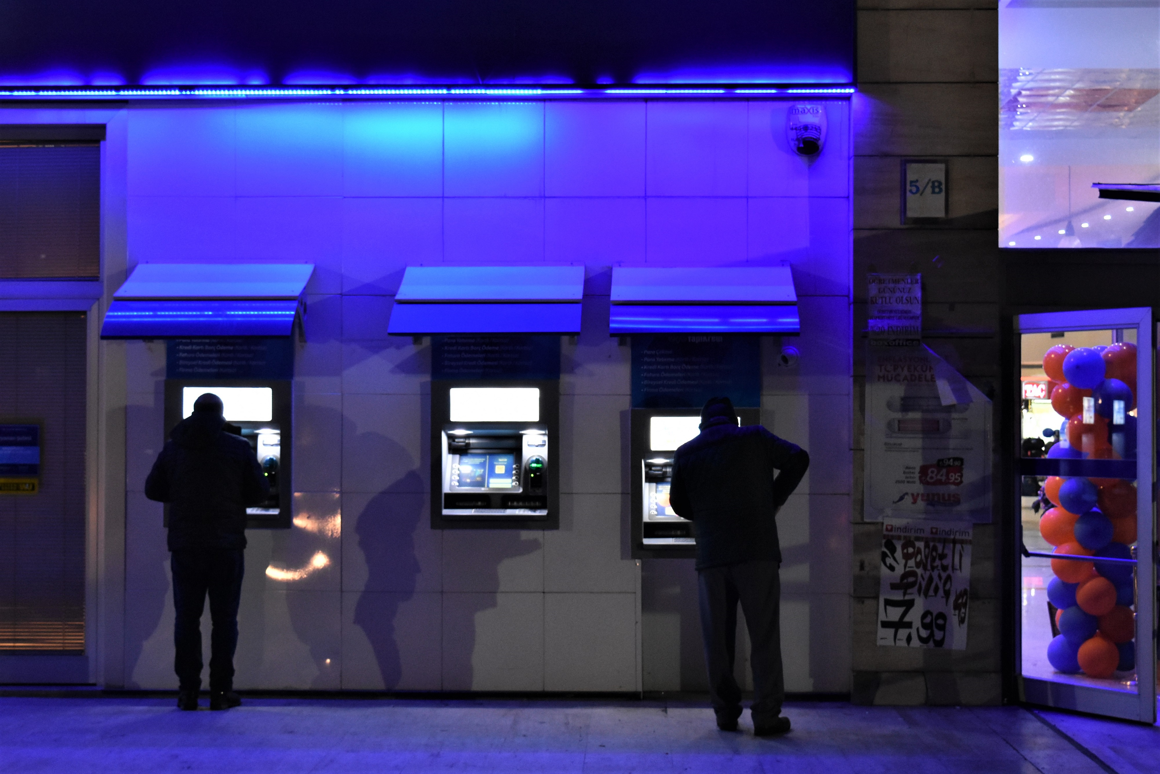People use an ATM machine in Ankara, Turkey on December 27, 2018. A year is passed under economic difficulties as part of high inflation rates and the Turkish lira's depreciation against foreign currencies since the first month of the year. Public and private sector employees with retirees are expecting a decent annual salary increase as the monthly minimum wage for 2019 has been raised to 2,020 Turkish liras (approximately 381 U.S. dollars), with an increase of 26.05 percent compared with the last year. However, the minimum wage decreased from 421 to 381 U.S. dollars comparing with the last year. (Photo by Altan Gocher/NurPhoto via Getty Images)