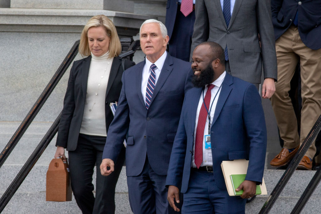 Secretary of Homeland Security Kirstjen Nielsen, Vice President Mike Pence and Ja'Ron Smith special assistant to the President of the United States exit the Eisenhower Executive Office Building on Jan. 05, 2019 in Washington, DC.