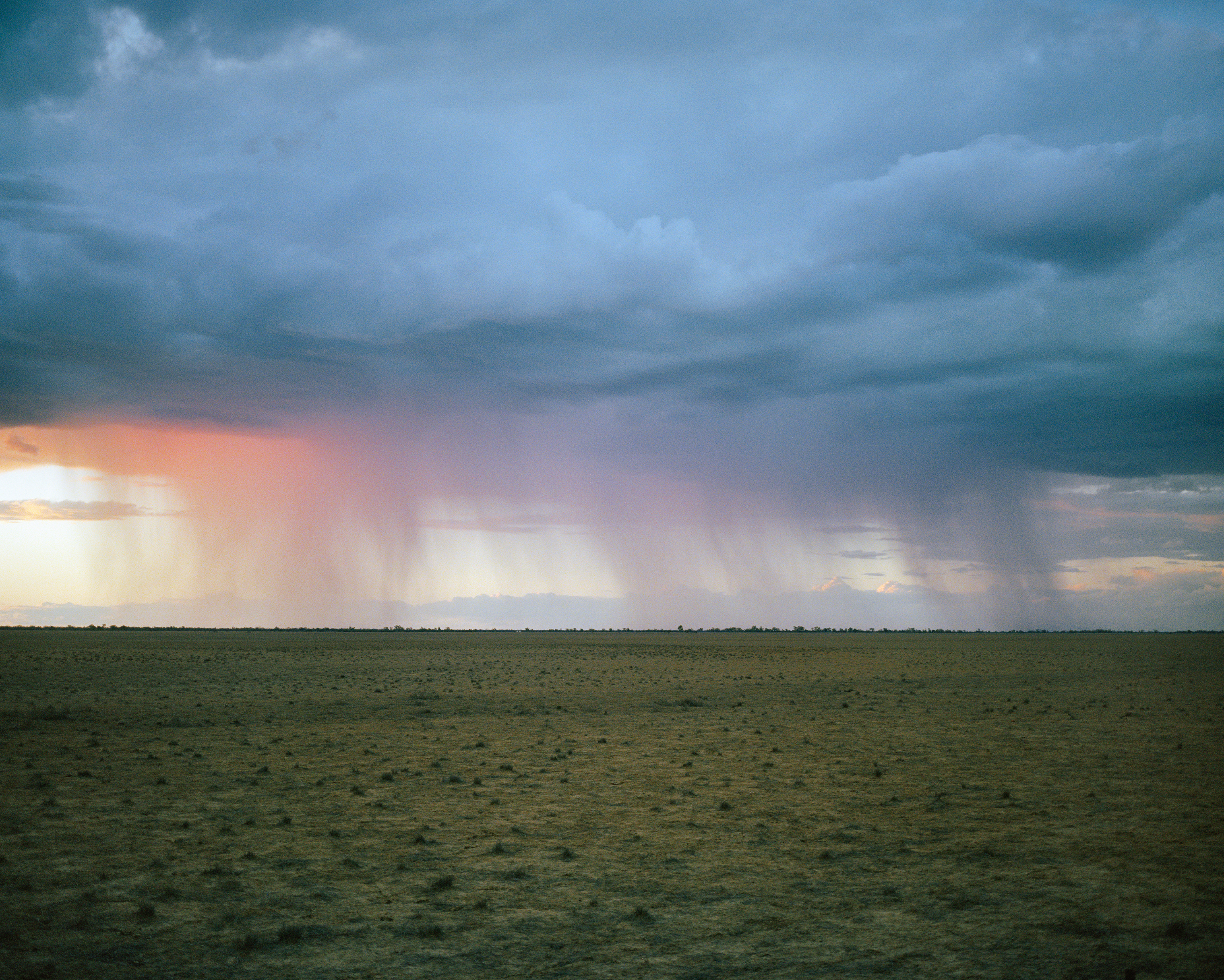 A storm moves across drought-affected land near Tuen, south of Cunnamulla, in Queensland in November.