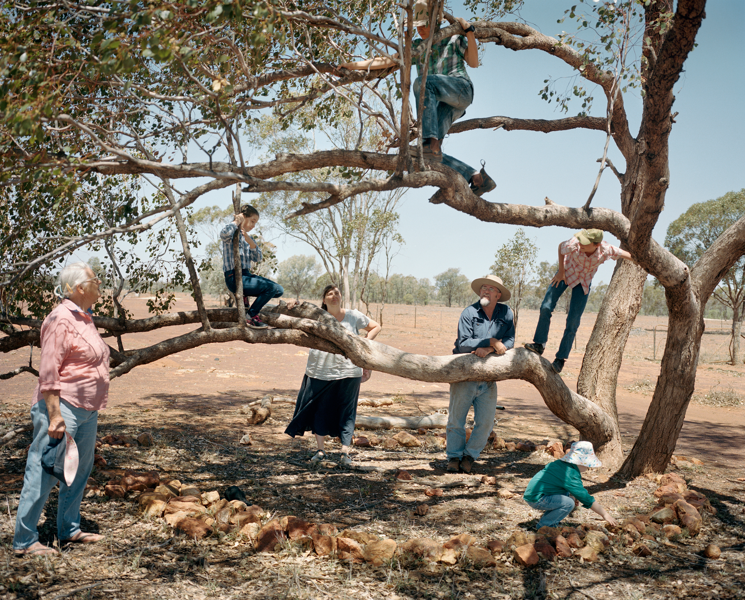 Farmers Kent Morris and Sam Cormack pose for a portrait with their children and his mother at Kandimulla Property in November. Financial pressure brought on by the drought caused Morris to find off-farm income; he now works at the municipal council in Mitchell.