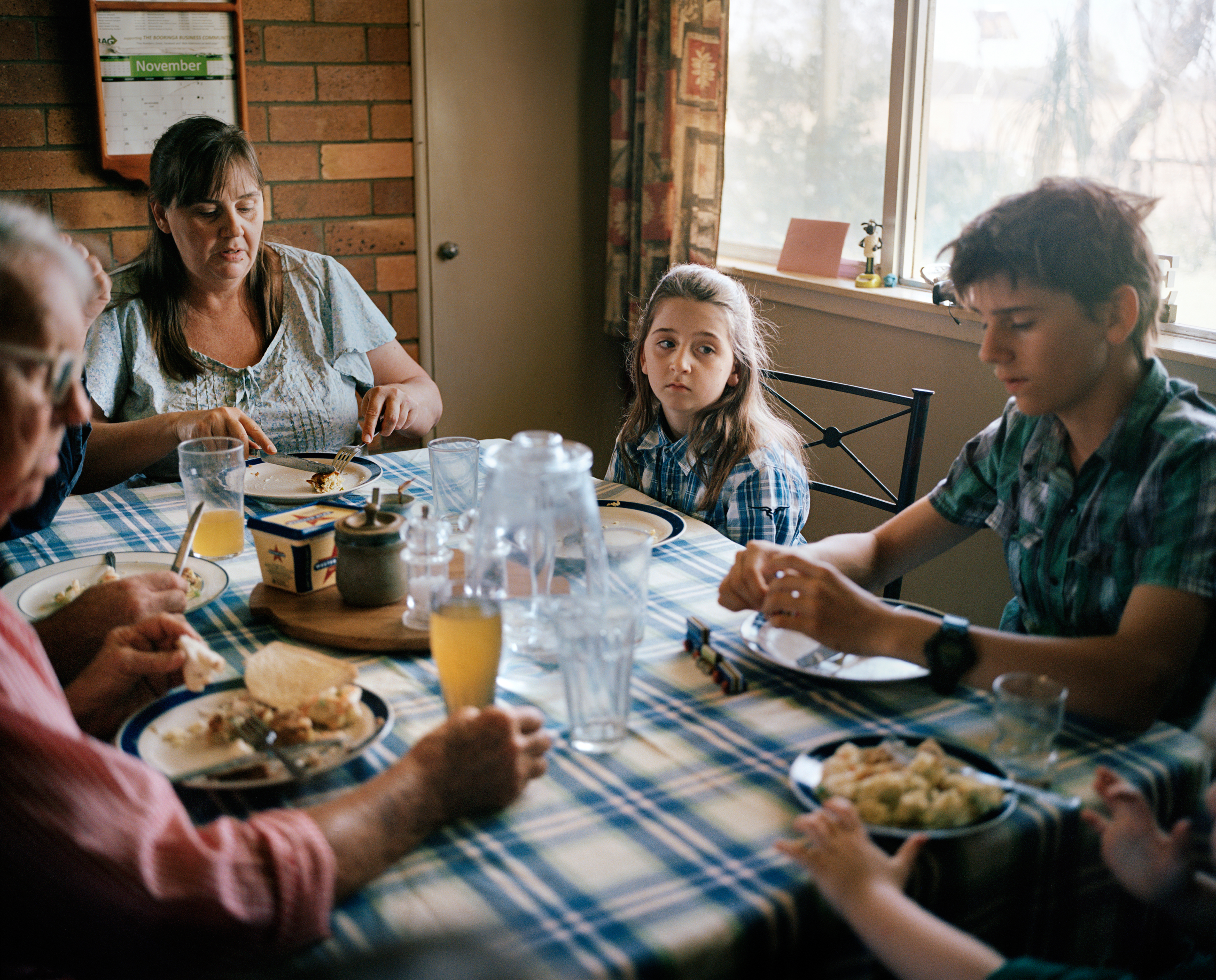 Farmers Kent Morris and Sam Cormack eat lunch with their children and his mother at Kandimulla Property in Queensland in November. Cormack has three children from a previous relationship — Grace, 9; Frank, 14; and Nicholas, 12 — and a son, Luke, 3, with Morris.
