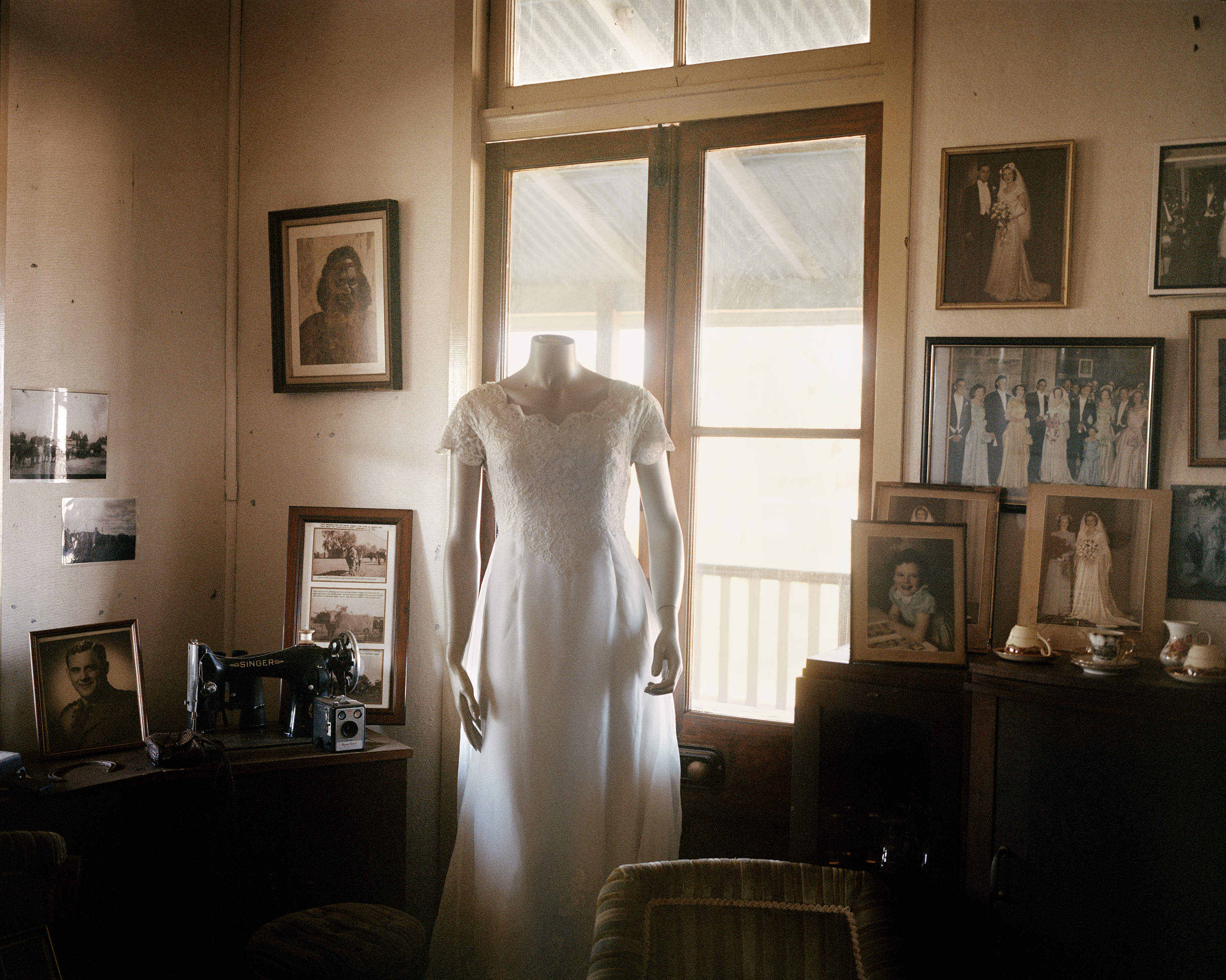 The wedding dress of Robyn Russell, 72, at her home on Charlotte Plains in Queensland in November. Russell lives and works her 69,000-acre property alone after her husband died of a brain tumor in 2011. Due to the drought, she describes herself  sliding into debt.  In 2001 she had 8,000 sheep but she has since destocked to a current 3,800. To supplement her farm income, she has established a tourism business on her property with historical tours and farm stays.