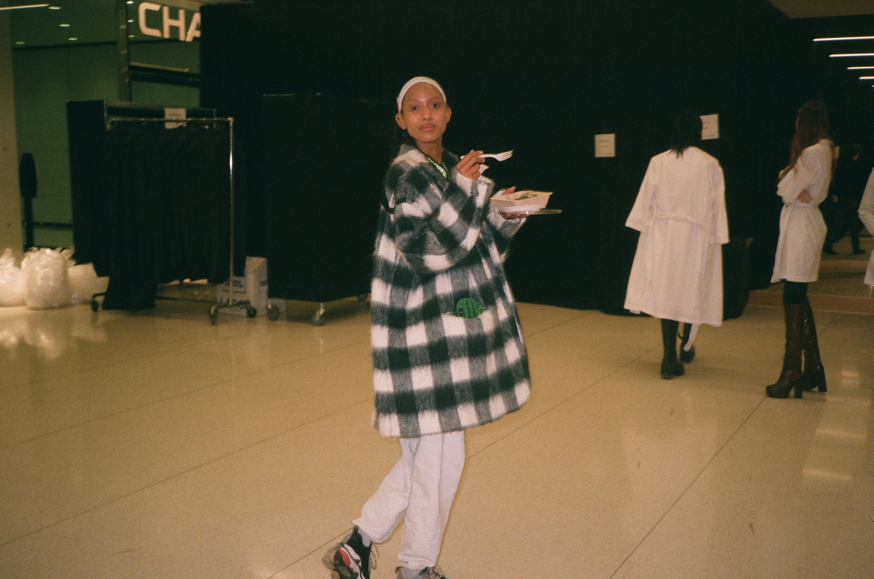Aighewi quickly eats in between runway walkthroughs and rehearsals.