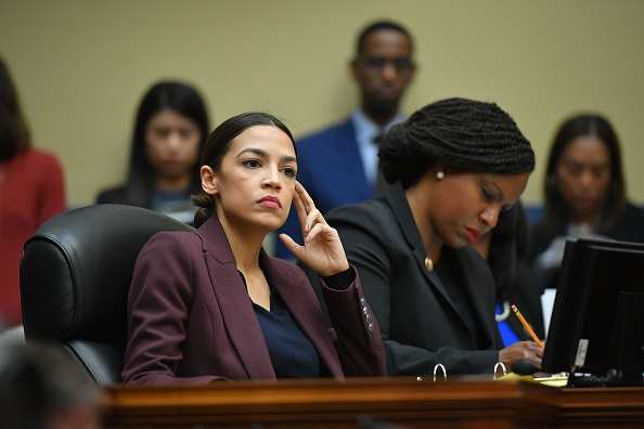 US Congresswoman Alexandria Ocasio-Cortez(D-NY) listens as Michael Cohen, attorney for President Trump, testifies before the House Oversight and Reform Committee in the Rayburn House Office Building on Capitol Hill in Washington, DC on Feb. 27, 2019.
