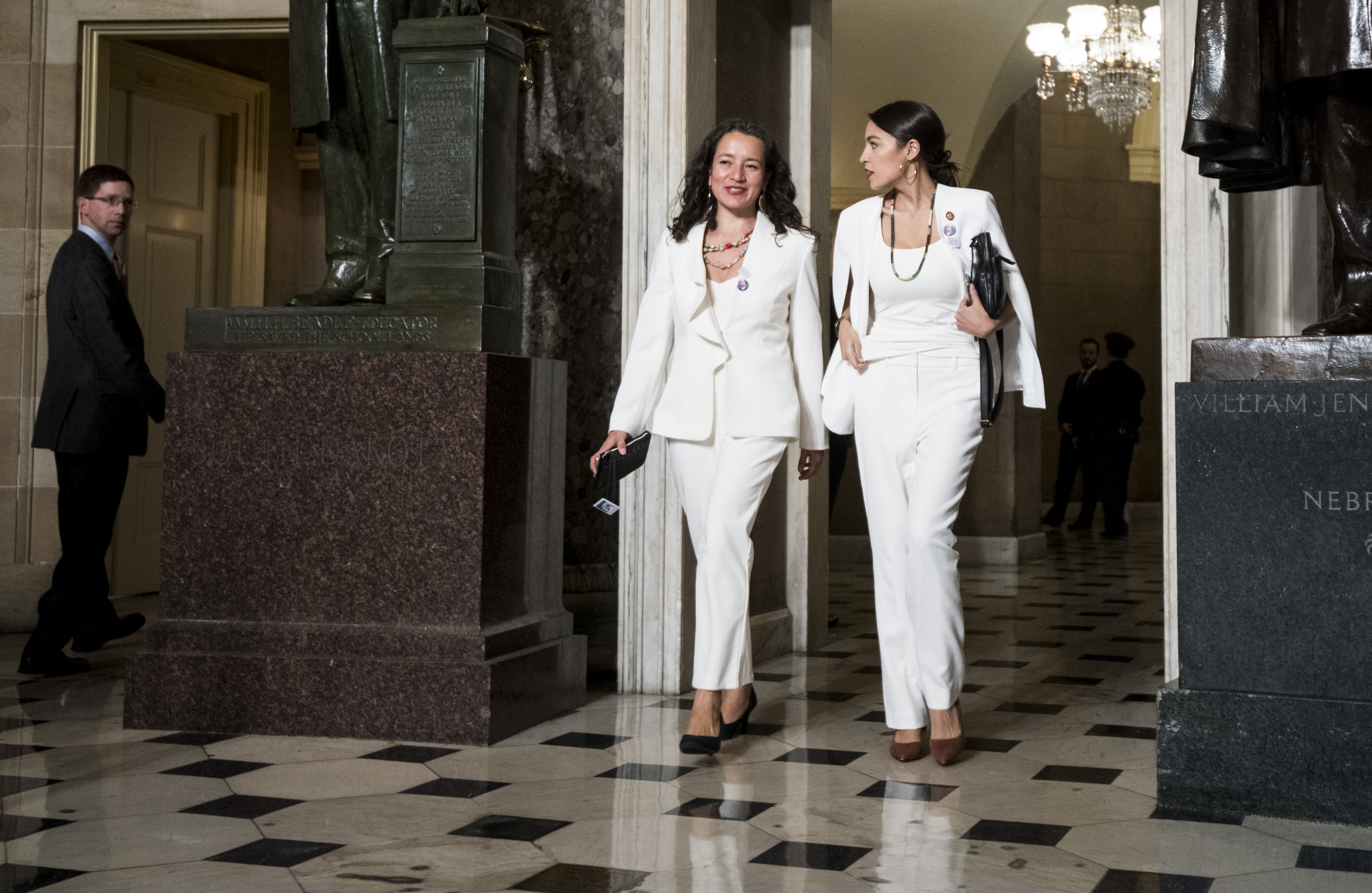 Rep. Alexandria Ocasio-Cortez, right, walks with her State of the Union guest Ana Maria Archila to the House chamber for President Donald Trump's State of the Union address to a joint session of Congress in the Capitol on Feb. 5, 2019.