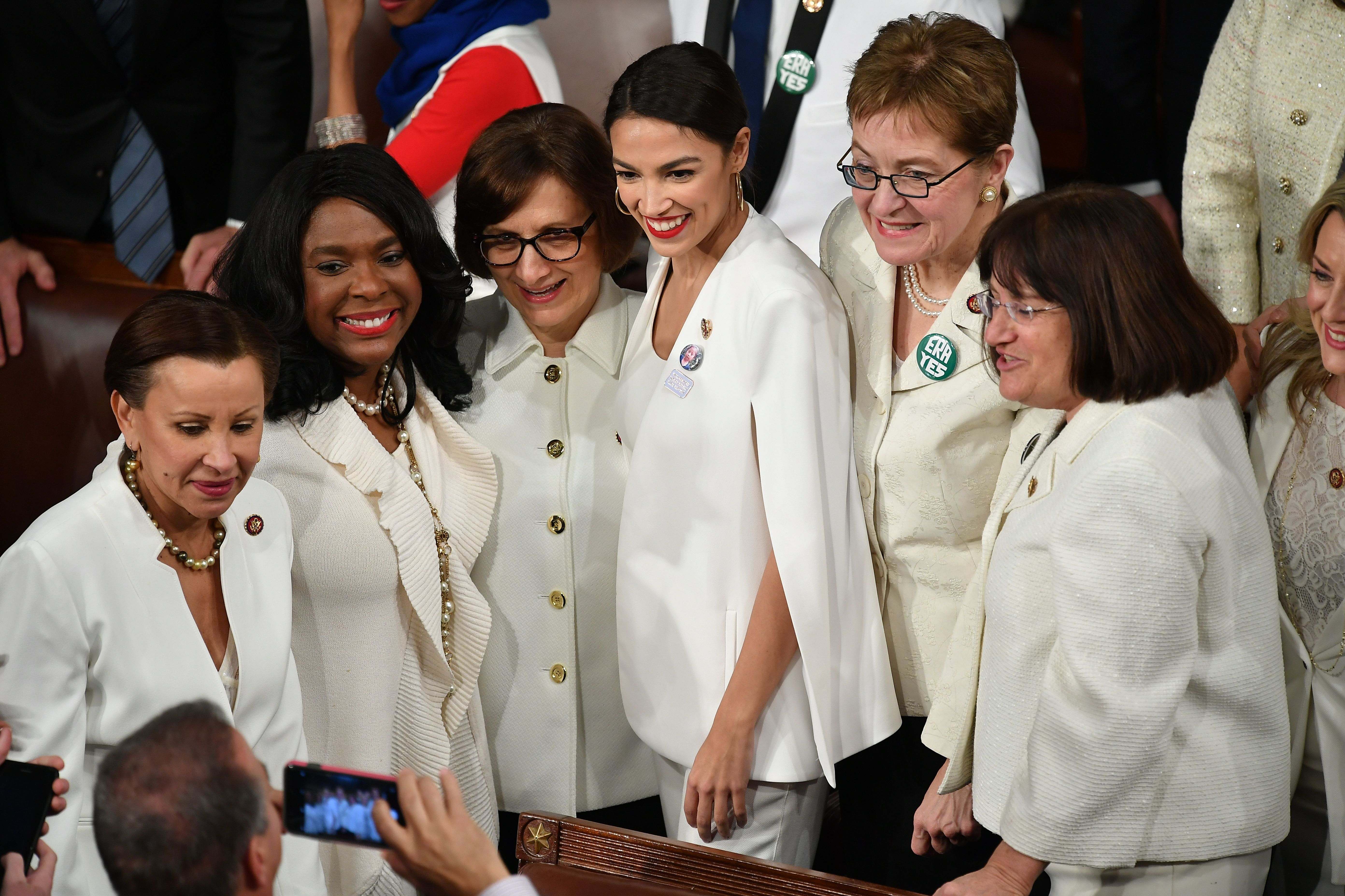 New York Representative (D) Alexandria Ocasio-Cortez (C) poses for a picture with other women ahead of U.S. President Donald Trump's State of the Union address at the US Capitol in Washington, D.C., on February 5, 2019.