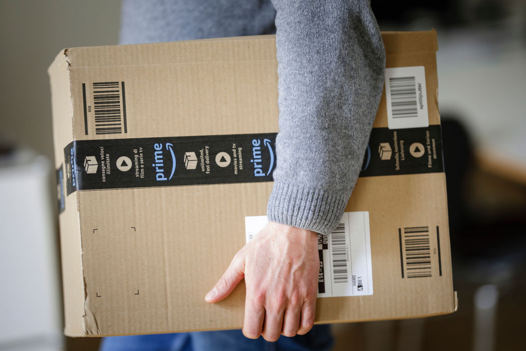A man is holding an Amazon Prime package on March 20, 2018 in Berlin, Germany.