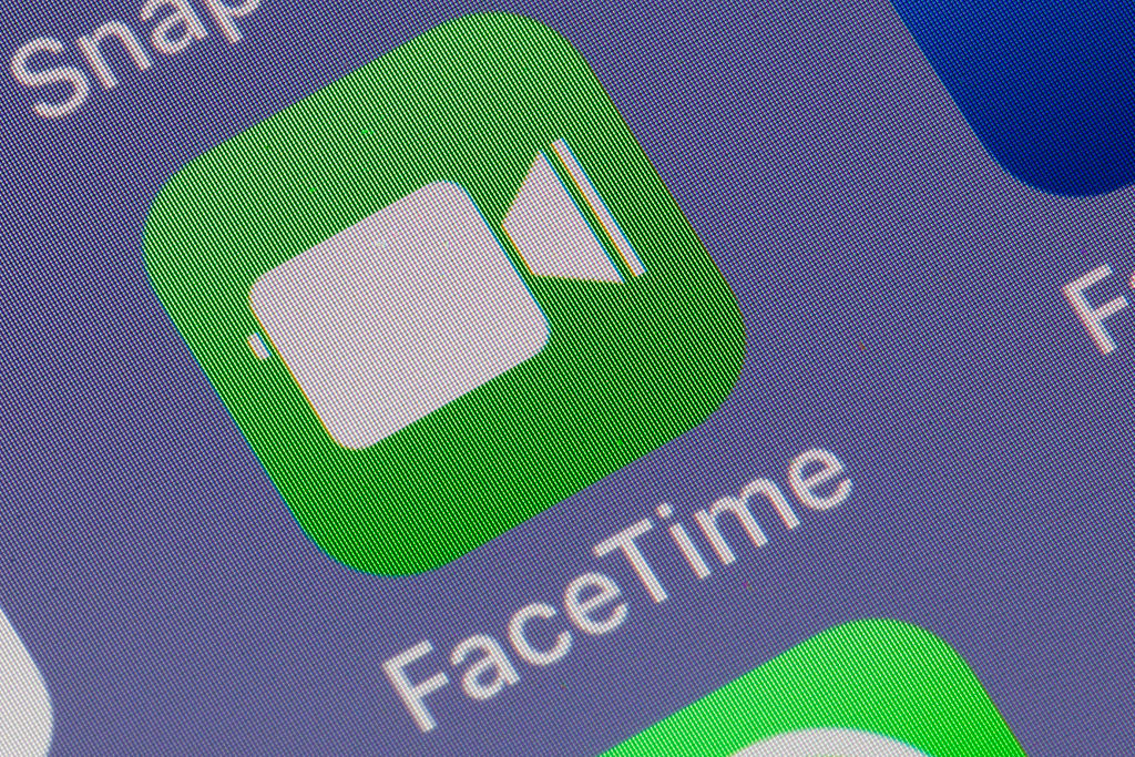 In this photo illustration, the FaceTime application logo is displayed on the screen of an Apple iPhone on Jan. 29, 2019 in Paris, France. An important security vulnerability has been discovered on FaceTime that lets people listen into others conversations without contacting them.