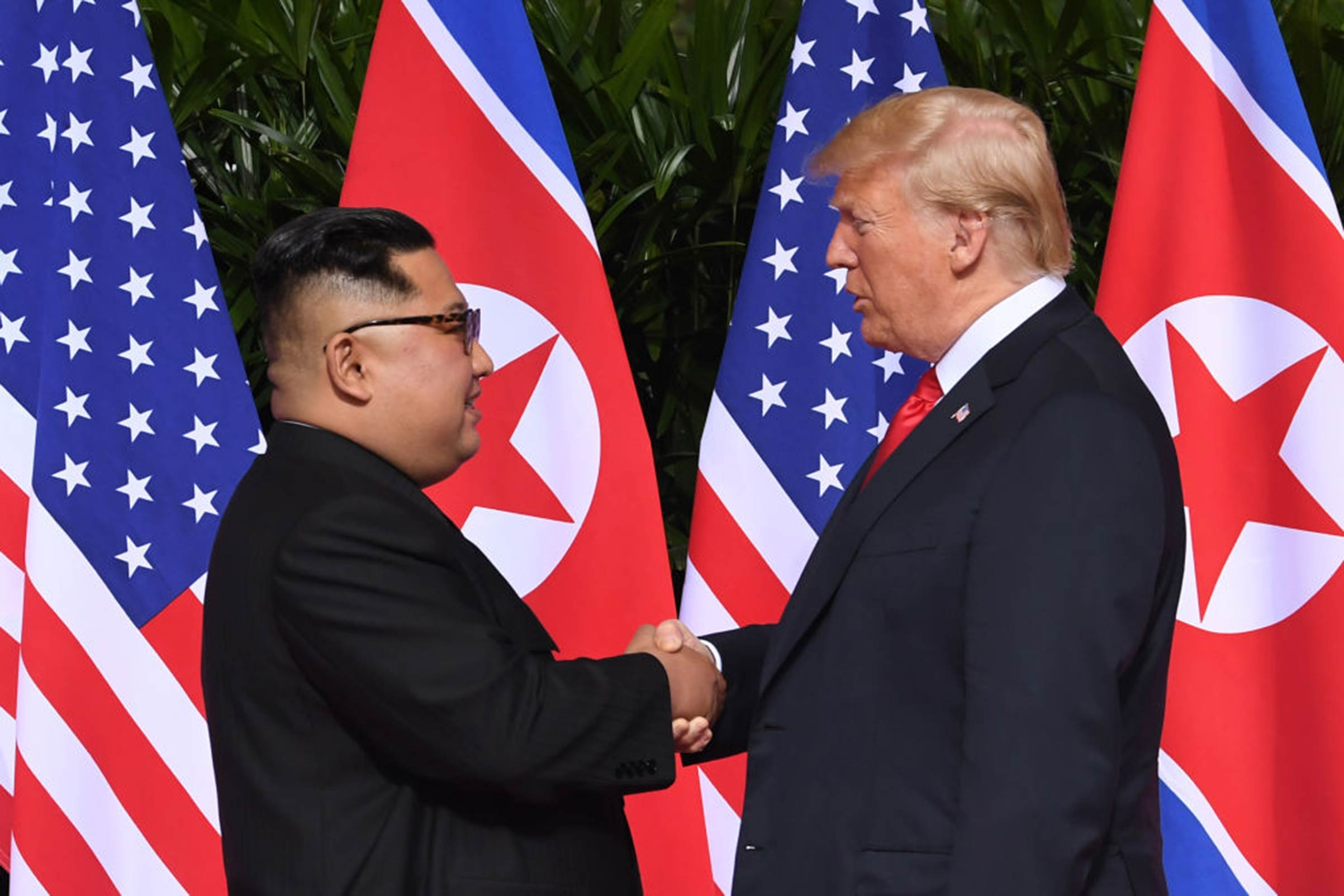 The President of the United States Donald Trump and North Korea's leader Kim Jong Un shake hands following a signing ceremony during their historic U.S.-North Korea summit on Sentosa island in Singapore on June 12, 2018.