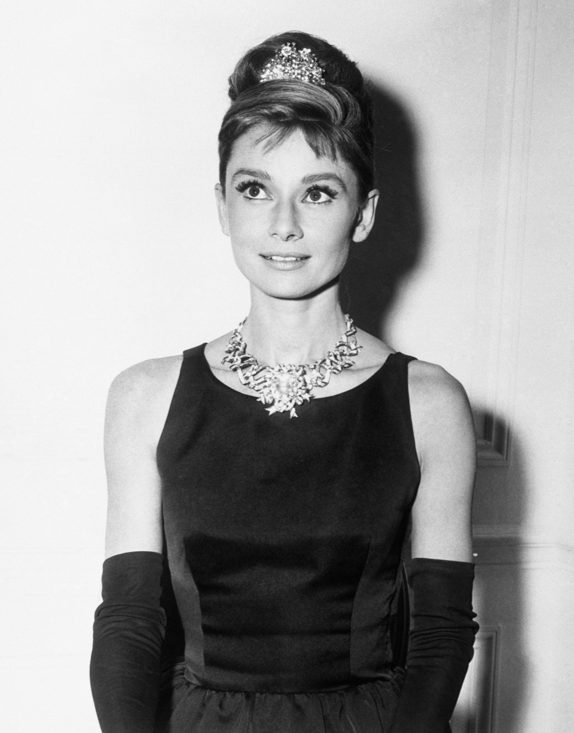 Audrey Hepburn, about to begin filming for Breakfast At Tiffany's, wears one of the store's most expensive diamond necklaces.
