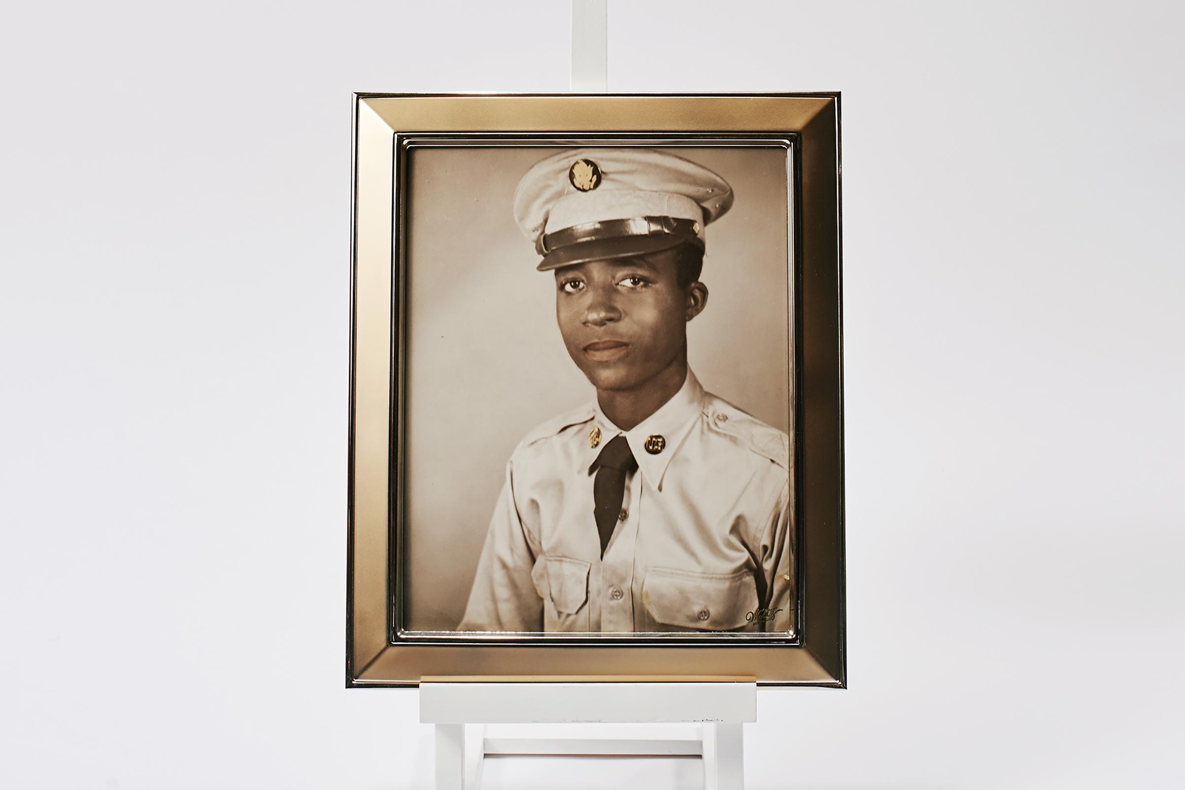 A framed portrait of Hoover, who left North Carolina for Korea in 1950.